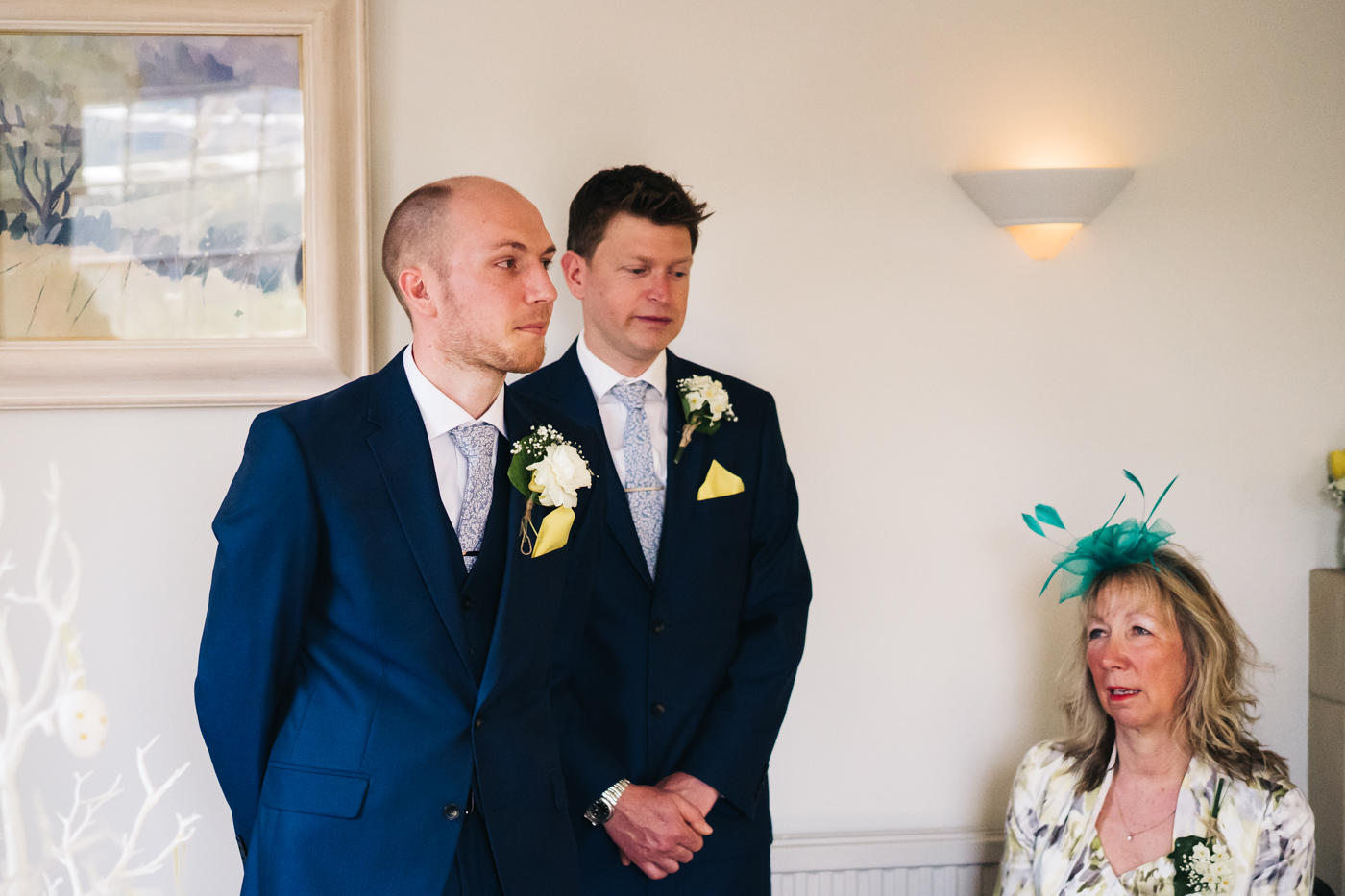 the groom stands and looks nervous at the bottom of the aisle. wedding at laskill house north yorkshire helmsley wedding photographer north east teesside