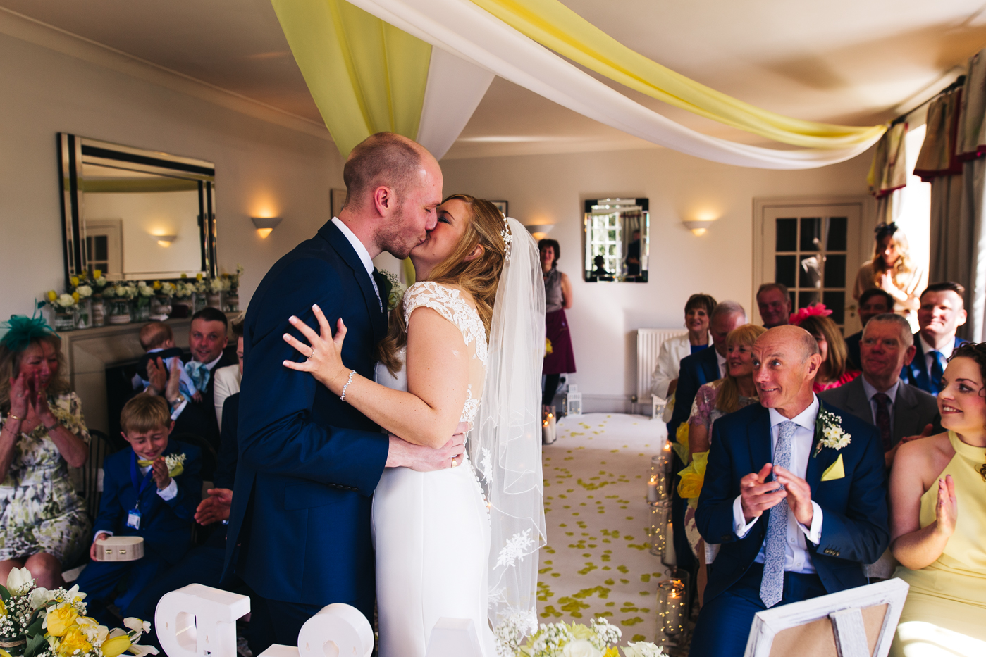 the bride and groom kiss during the ceremony. wedding at laskill house north yorkshire helmsley wedding photographer north east teesside