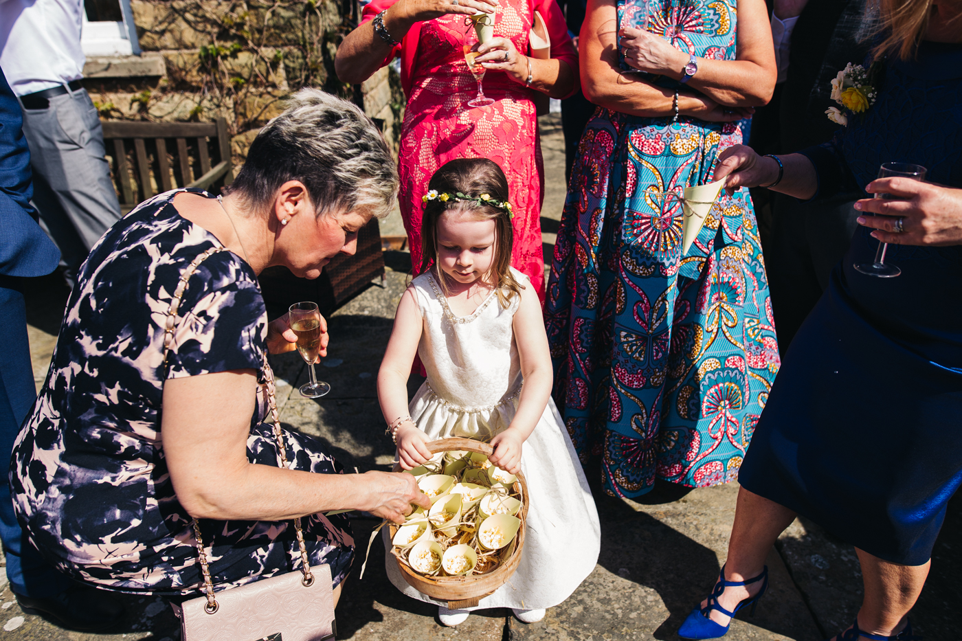 a flowergirl hands out confetti cones. wedding at laskill house north yorkshire helmsley wedding photographer north east teesside