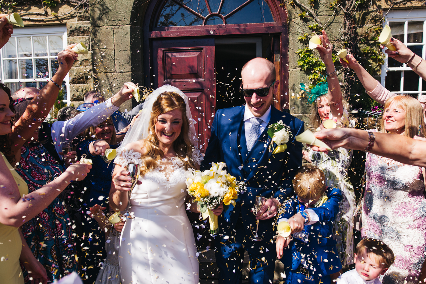 a confetti shot of the couple. wedding at laskill house north yorkshire helmsley wedding photographer north east teesside