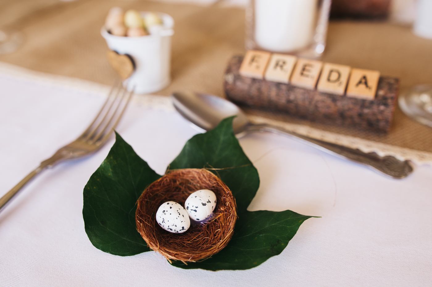 the details of the wedding table - wooden name places and birds nests. wedding at laskill house north yorkshire helmsley wedding photographer north east teesside