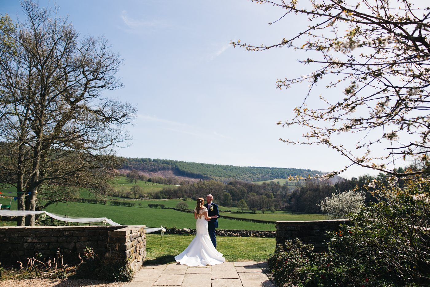 a wide shot of the couple standing with the yorkshire view in the background. wedding at laskill house north yorkshire helmsley wedding photographer north east teesside