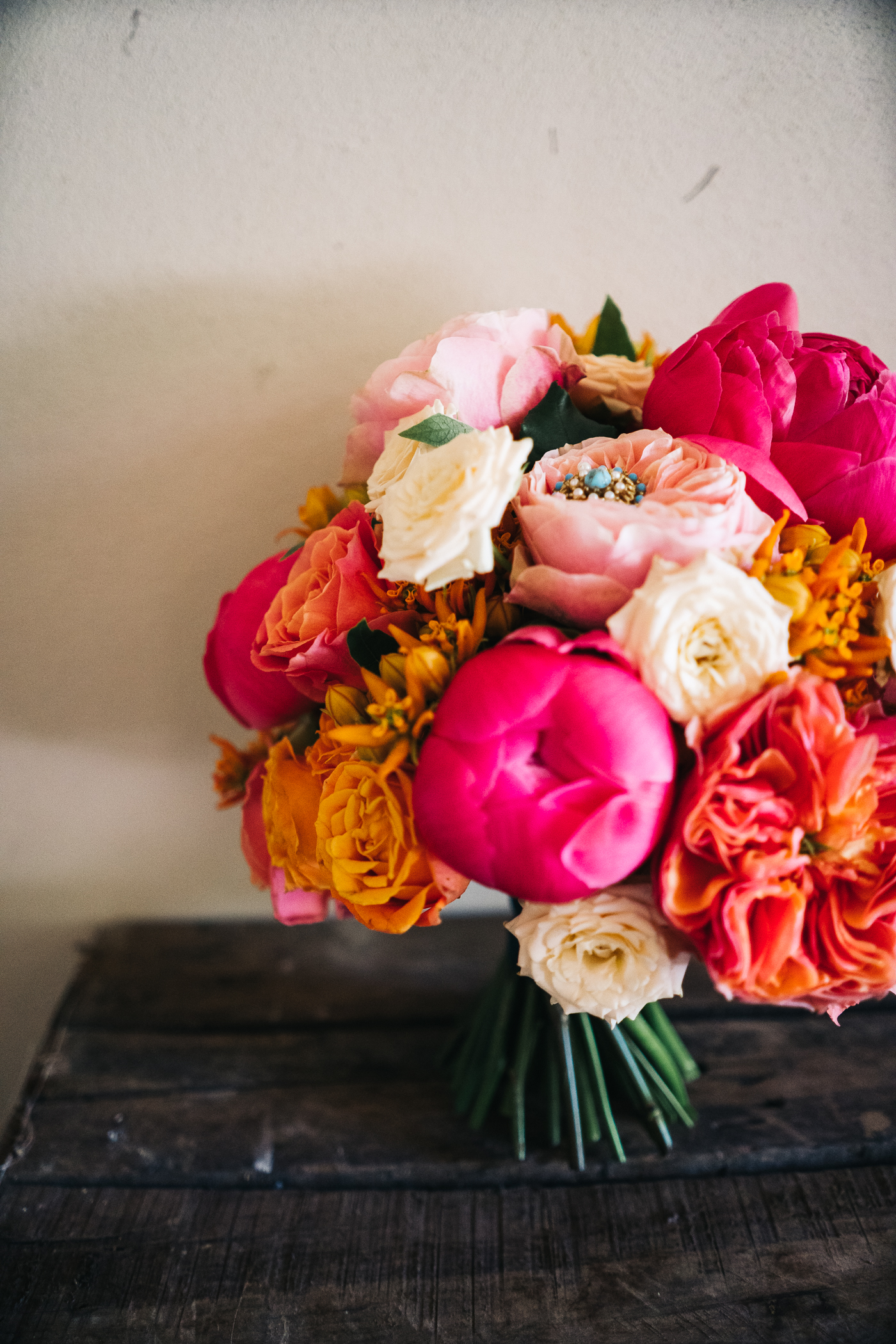 orange, pink and deep pink bouquet. photo by sally t photography, wedding at ever after, tavistock, devon photographer