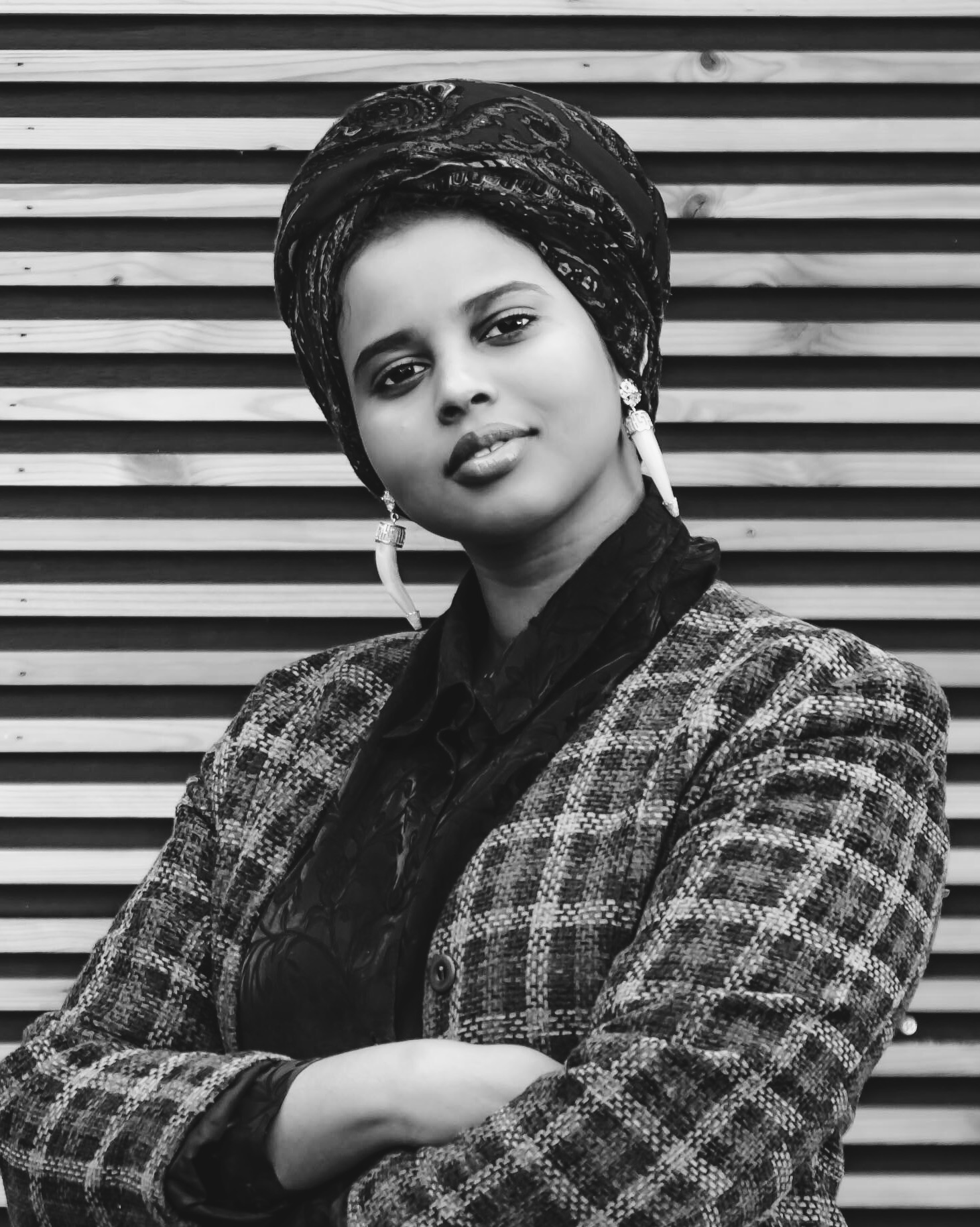 Momtaza Mehri  is a British-Somali poet, essayist and editor, and is the current Young People's Laureate for London. Her work has been featured in  Poetry Review ,  BuzzFeed , BBC Radio 4,  Vogue  and the San Francisco Museum of Modern Art's Open Space. She is a Complete Works Fellow, and winner of the 2017 Out-Spoken Page Poetry Prize and the 2018 Brunel African Poetry Prize.  Her chapbook  sugah.lump.prayer  was published as part of the New Generation African Poets series. Her poems also feature in  Ten: Poets of the New Generation , published by Bloodaxe Books in 2017. Momtaza Mehri's participation is made possible with the assistance of Words Go Round, an outreach programme of Singapore Writers Festival. (Photo credit: Lee Townsend, for Spread the Word)