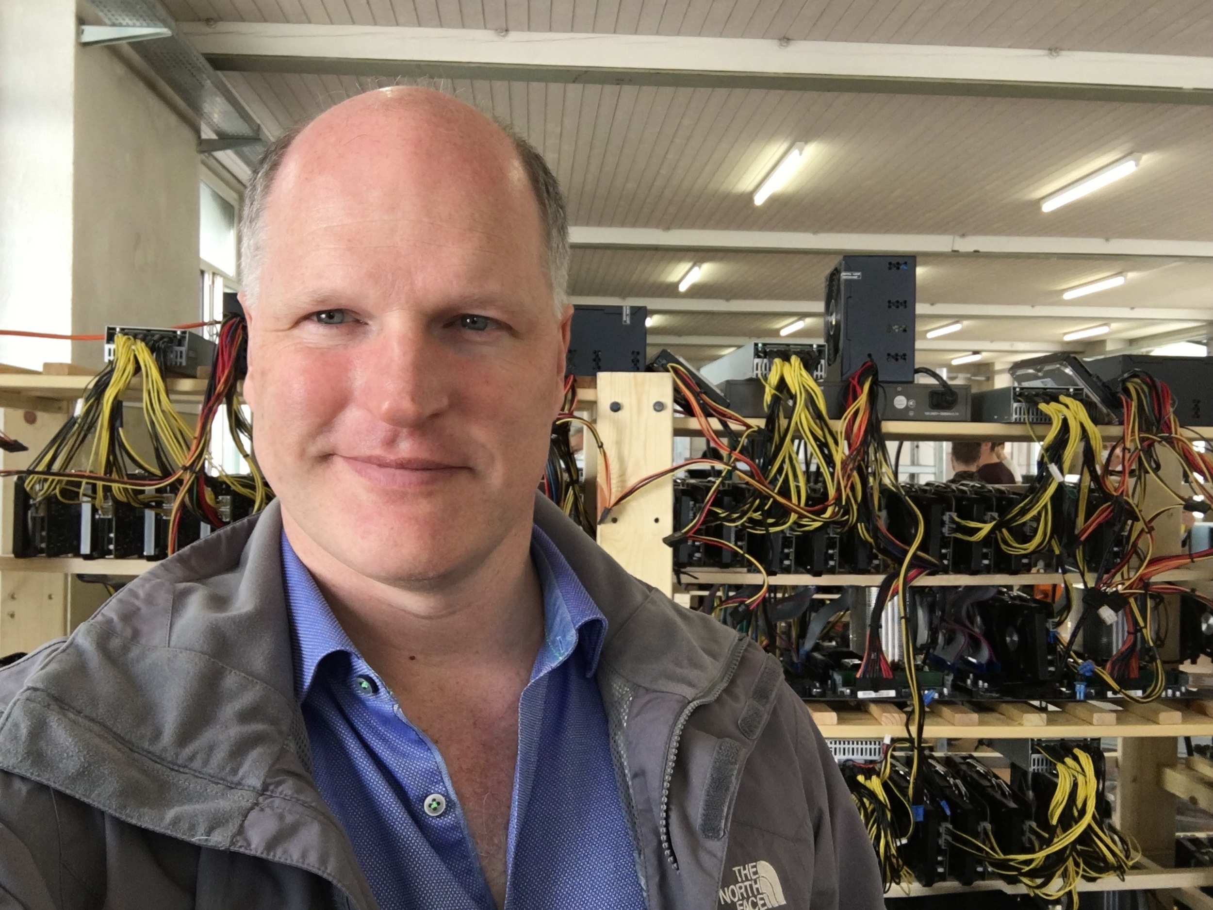 Visiting a bitcoin mine, where electricity is turned into bitcoin, heat, and fan noise.