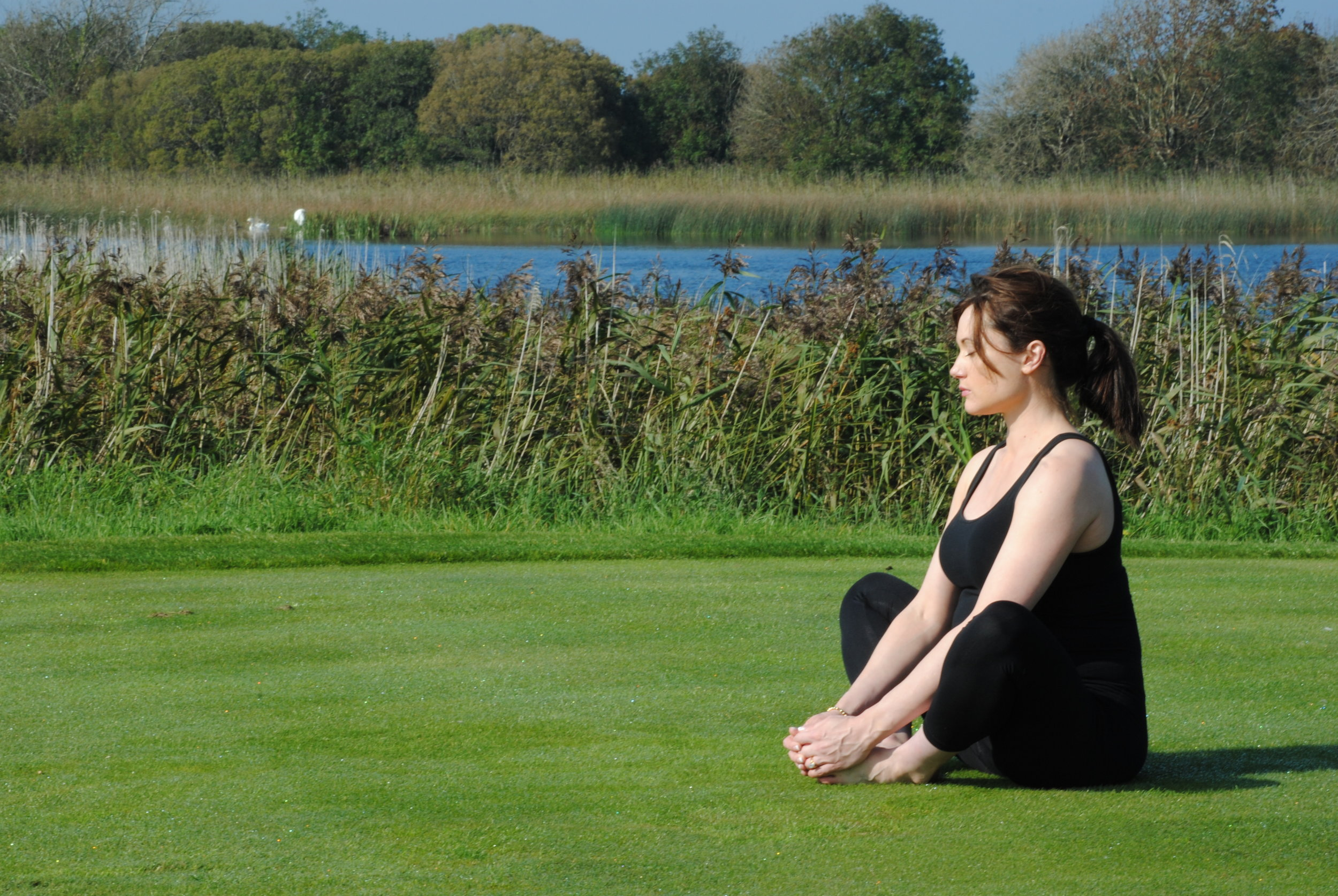 Deirdre, one of Anna's private clients enjoying a mindful nature meditation, at Glenlo Abbey, Galway.