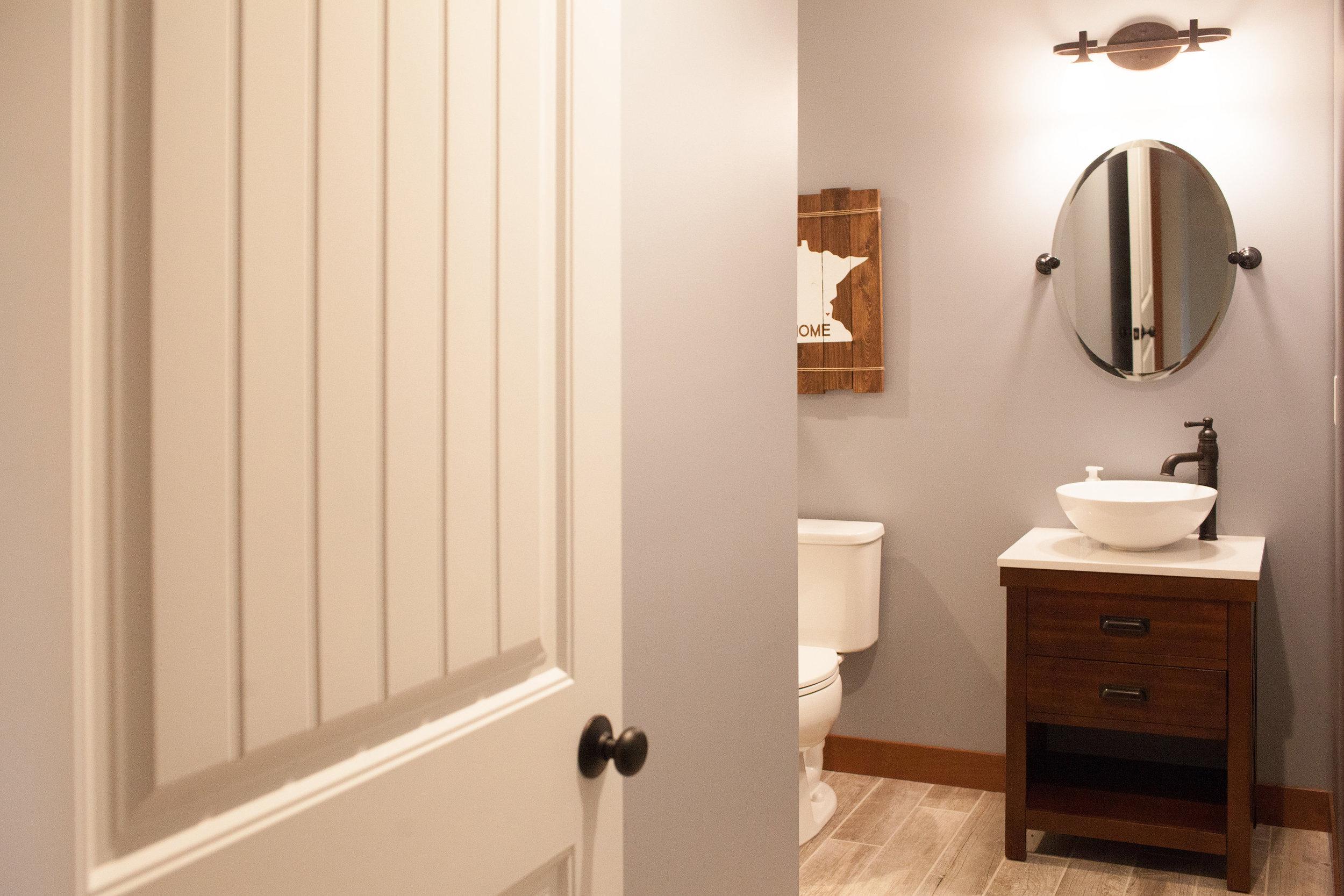Three-quarter bath in Andover basement renovation by Professio