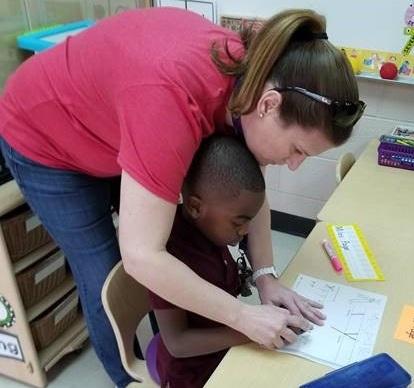 AZ+Kelley+Photo-+teacher+helping+student