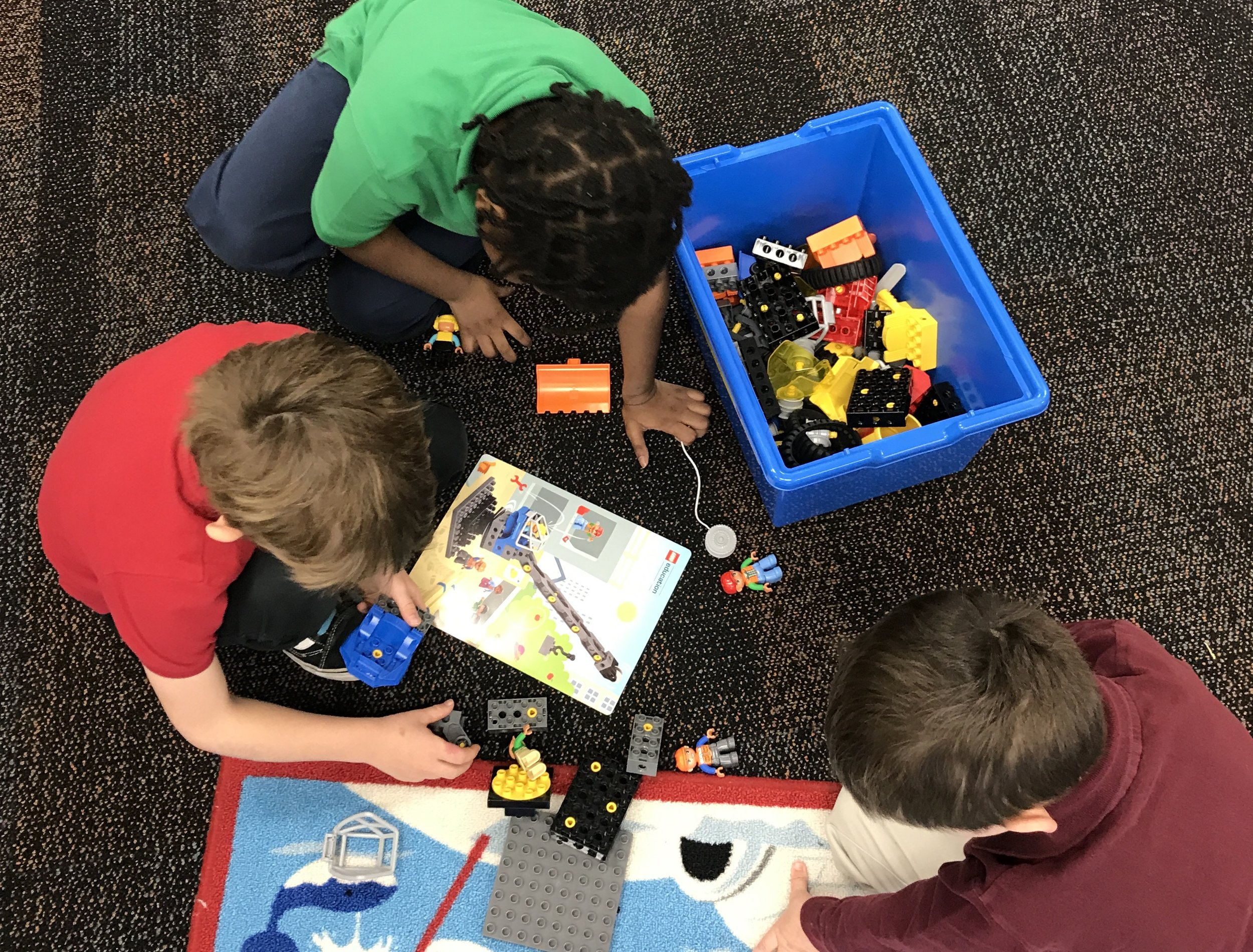 Students collaborate to build machines in an after-school LEGO Club