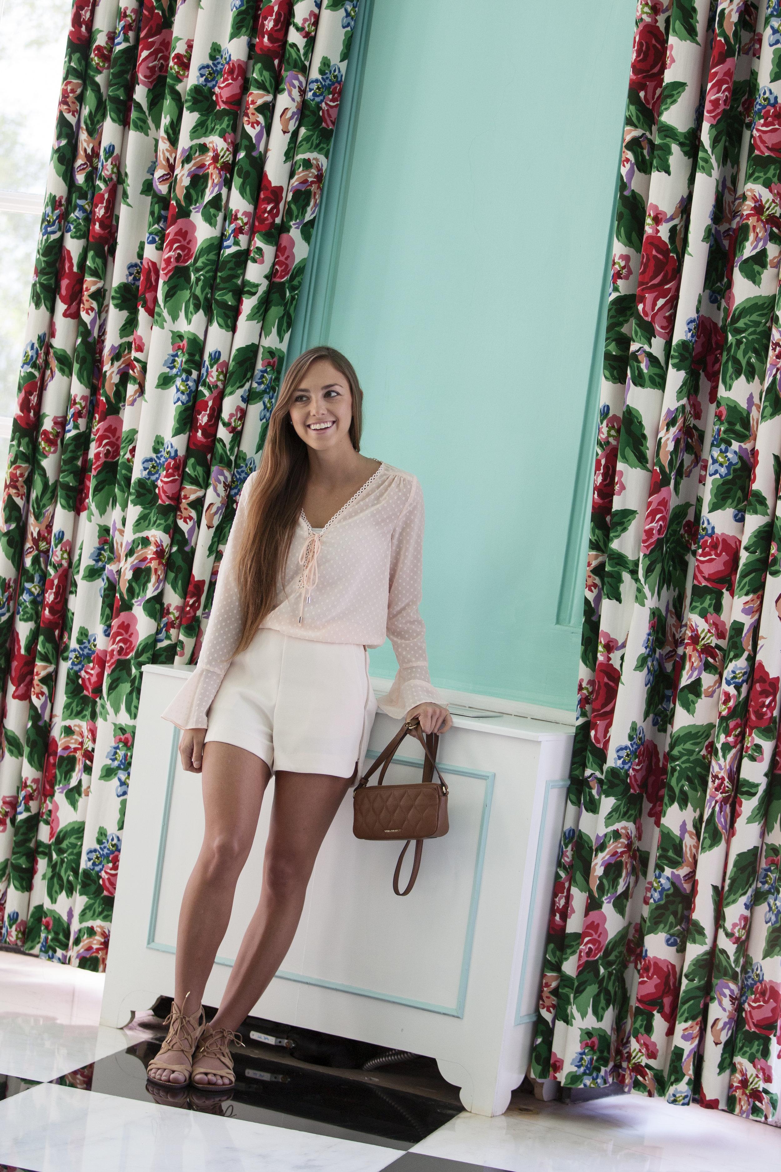 Clothing:  Lucy Paris Blouse -$84, Lucy Paris Shorts - $84 -  Belle & Beau  Accessories:  Quilted Sydney Bag by Vera Bradley- $148 -  Crepe Myrtle Bags & Beads   Shoes : Sam Edelman - $100  - Yarid's