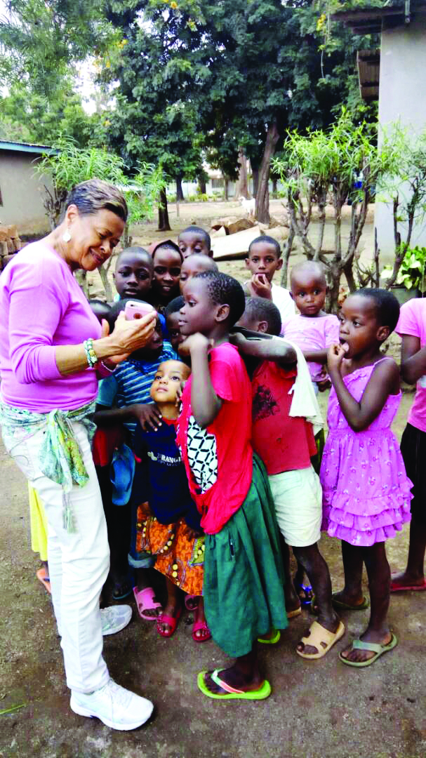 Janice Cooley with village children