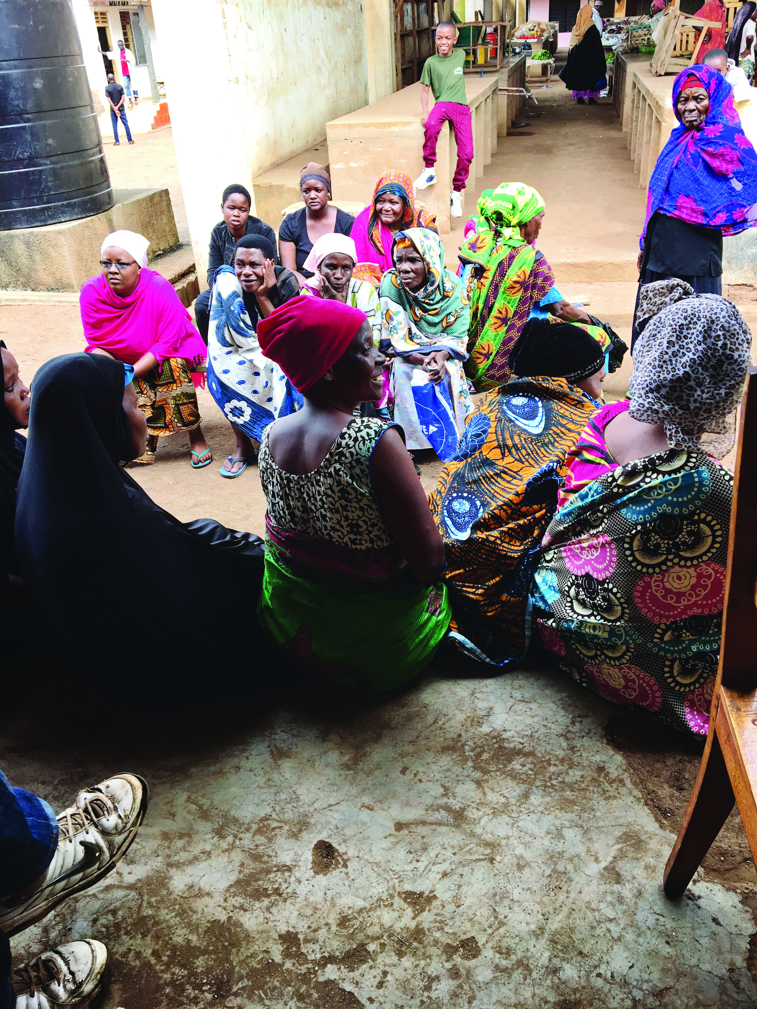 Patients wait in line at village outreach clinic.