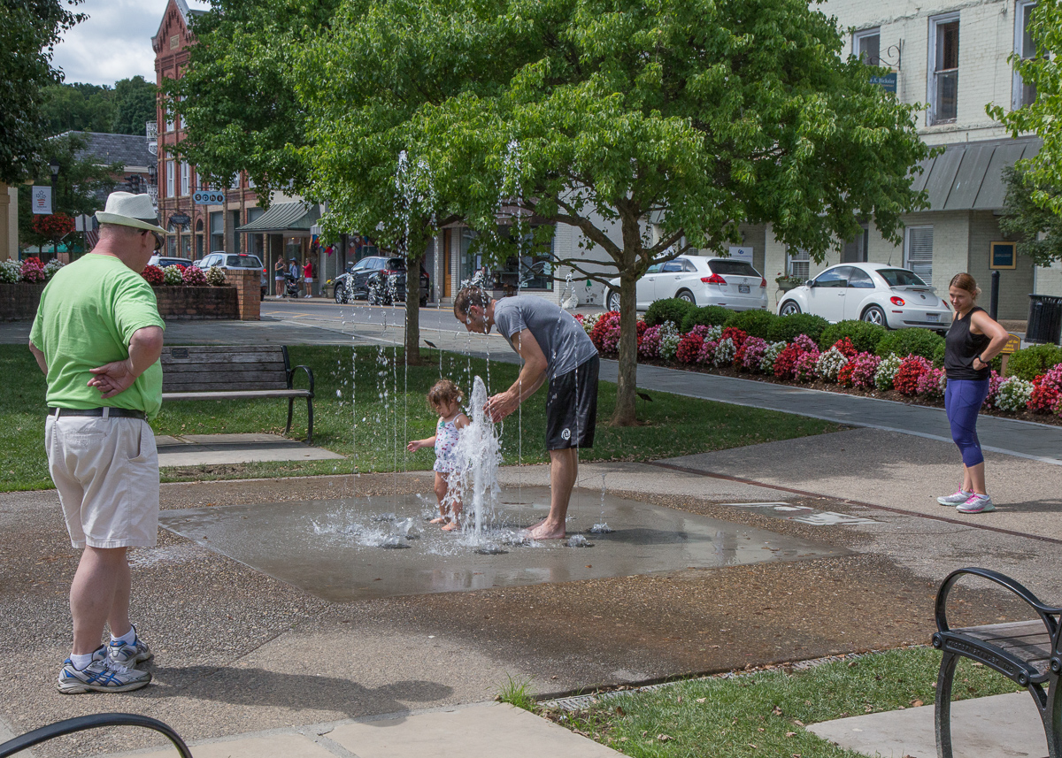 Watching granddaughter Gemma enjoy play fountain in downtown Lewisburg, 2018.