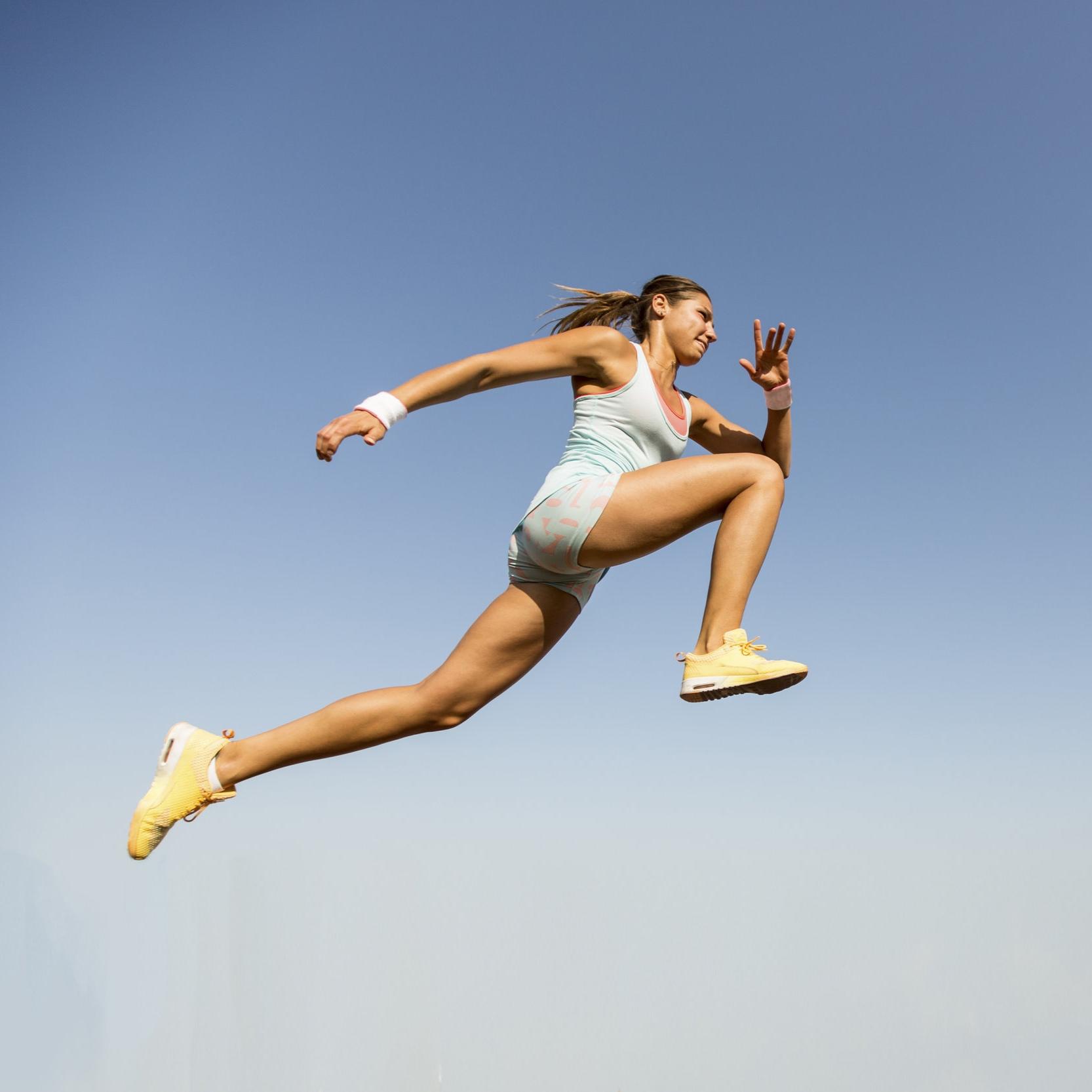 female-athlete-running-jumping