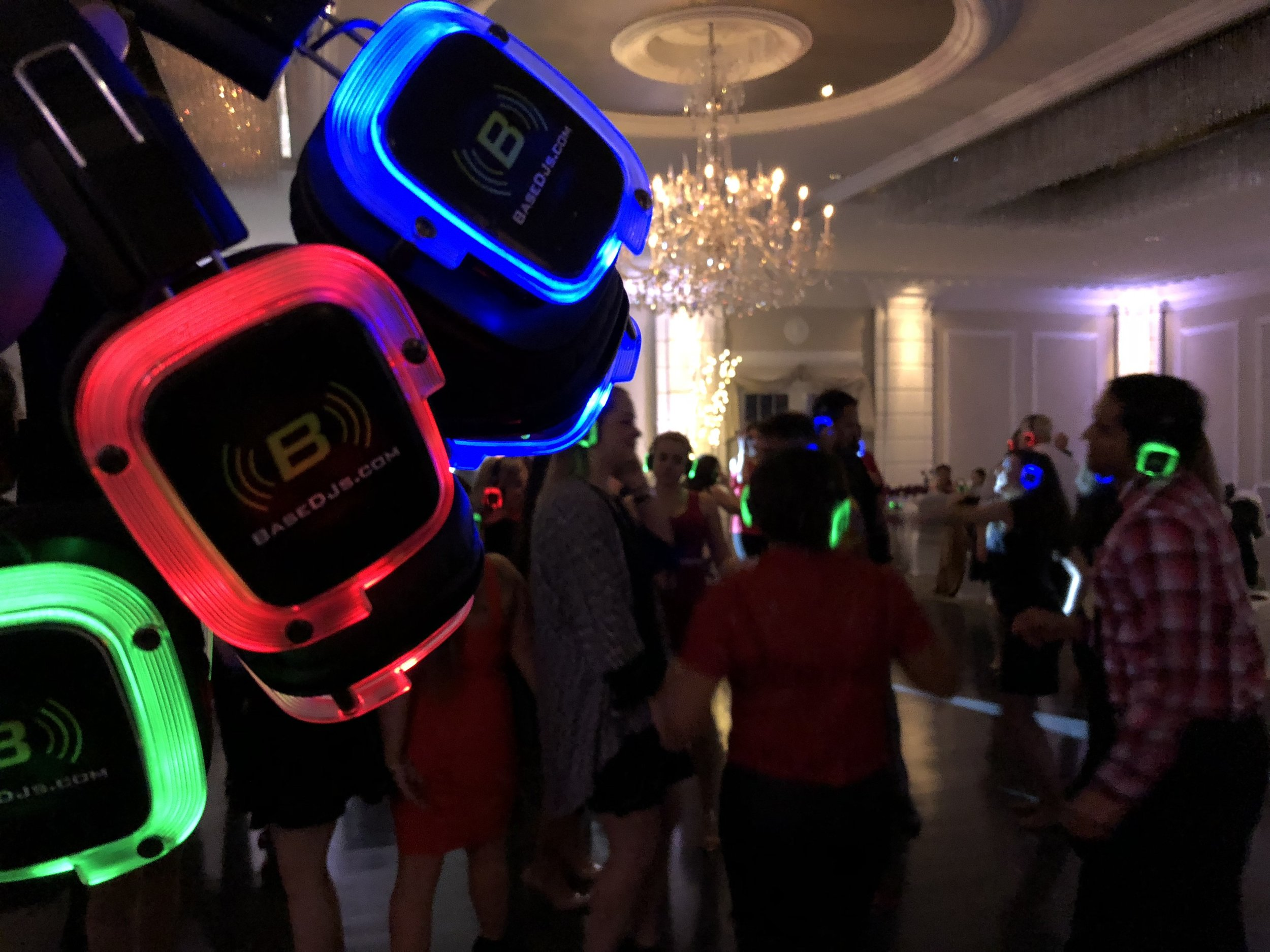 Silent Disco - Shhhhh..... There isn't music playing. It's all in your head. We pass out wireless headphones with three channels on them. Each channel has a different genre or style of music with one being the live DJ.