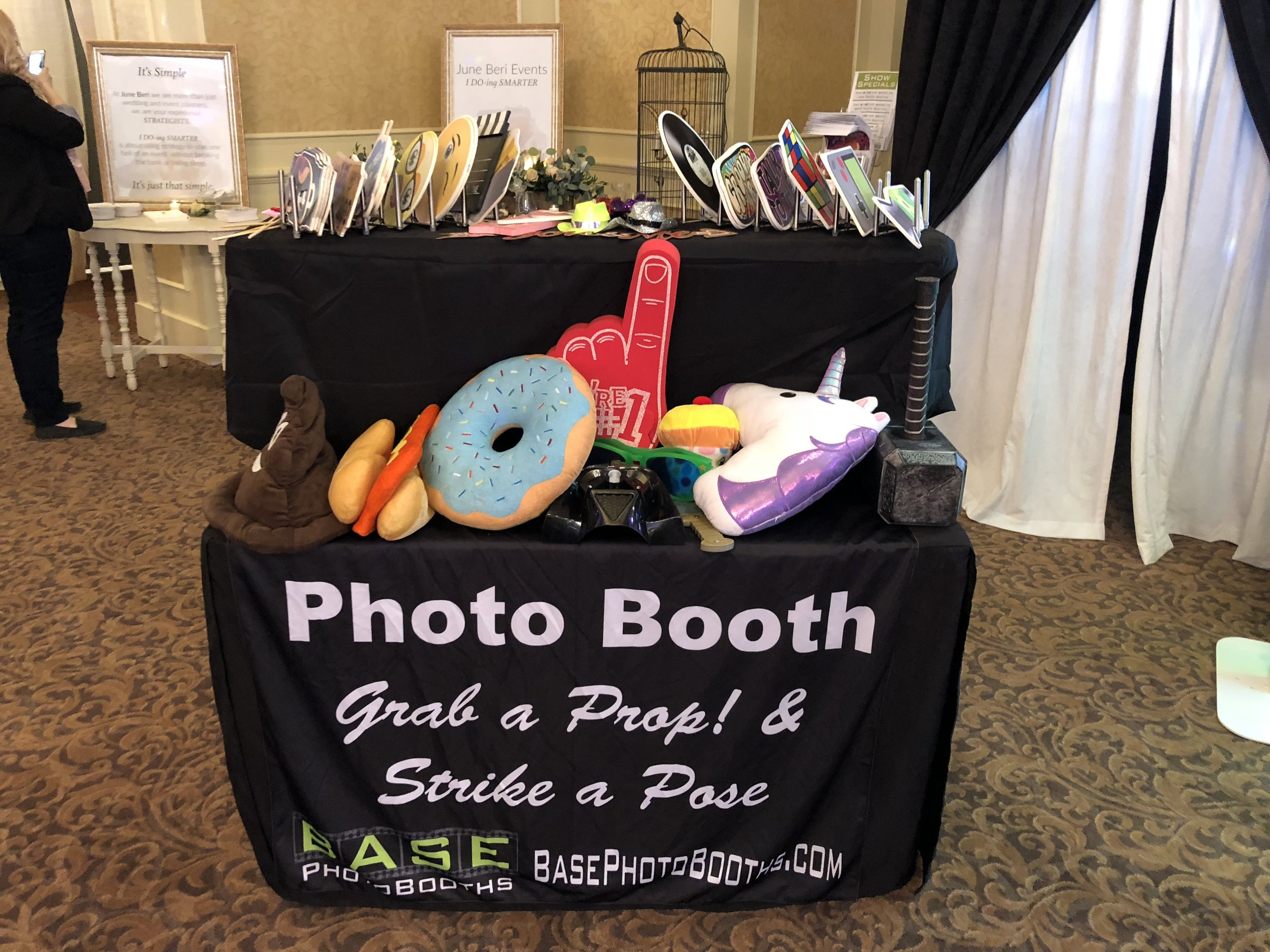 Free Premium Props - An Entire Two Tiered Props Table with Signs, Hats, Foam Fingers, Thor Hammers, and More.