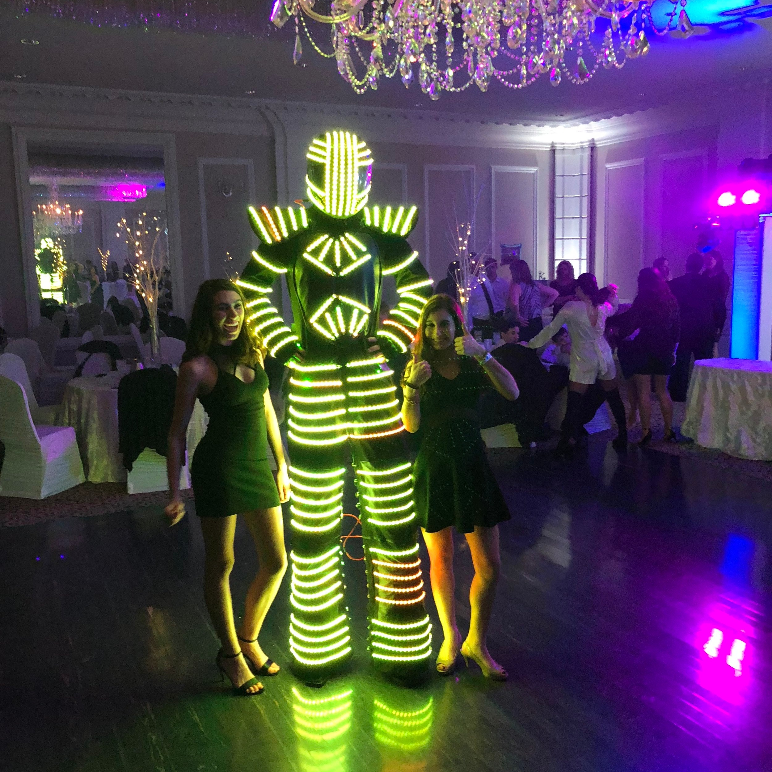 LED Dancing Robot $495 - Add in our LED Dancing Robot. Coming in at over 7ft tall, the robot has his own built in light show and will entertain your guests for an hour show!
