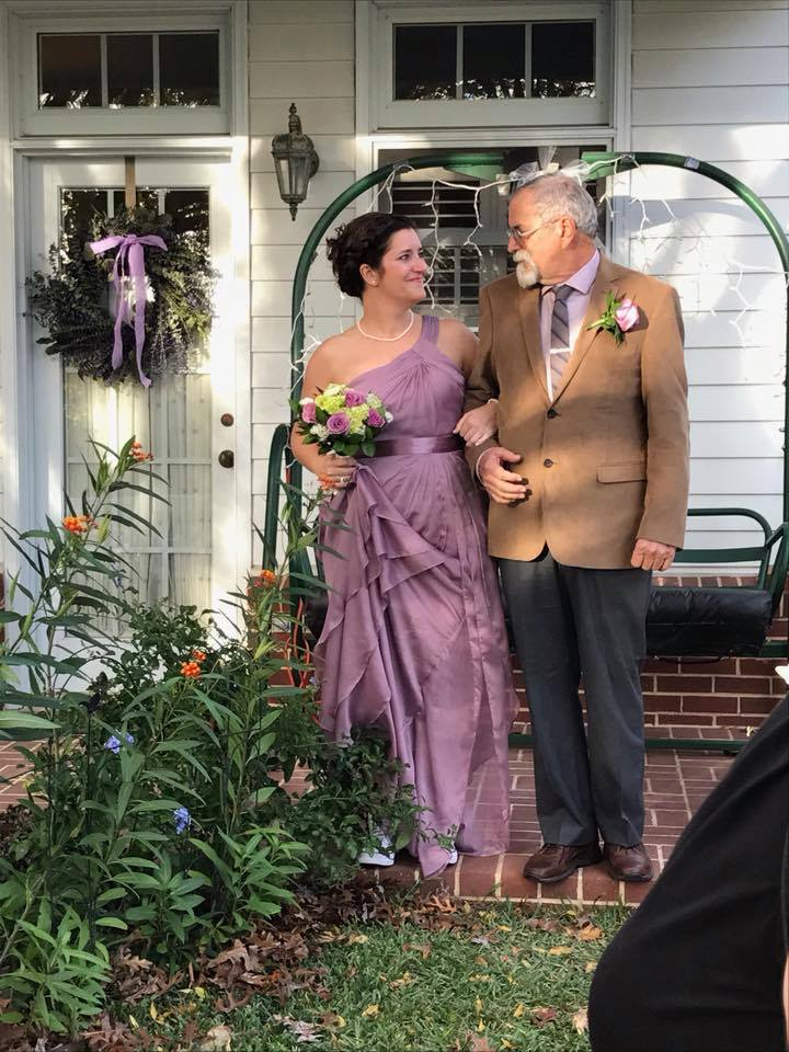 My father and his clothes made it Dallas just in time to walk my sister and her purple dress down the aisle.