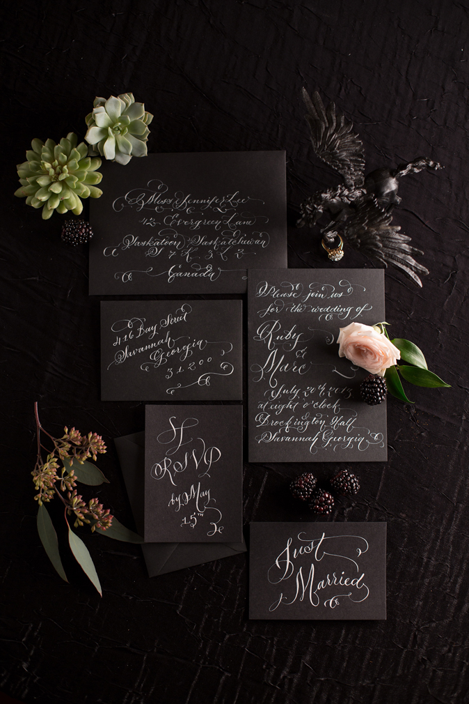 white ink calligraphy on black laura lavender calligraphy