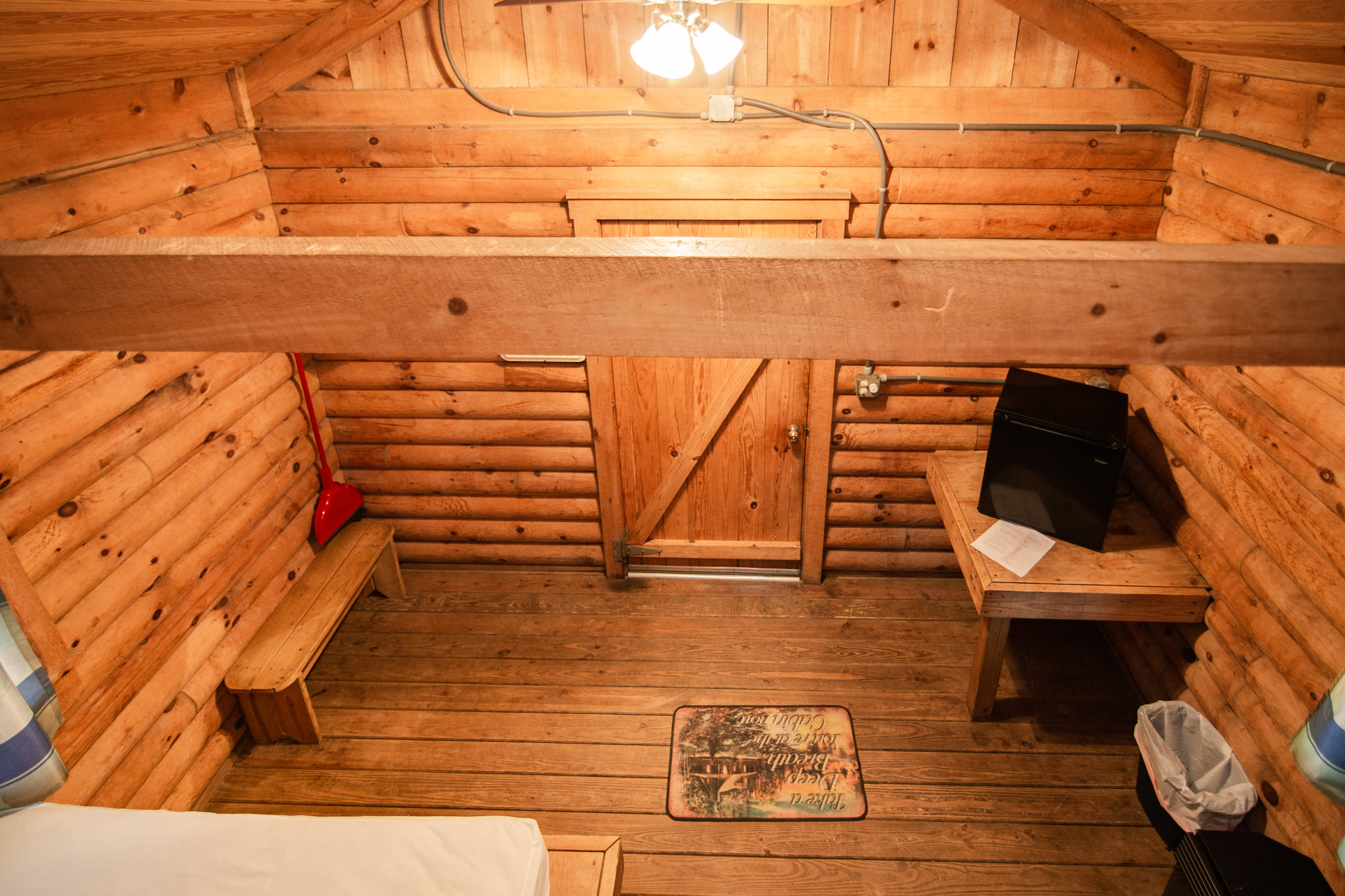 The view from the upper twin bunks of K4 is of the rest of the cabin, including the lower twin bunk and the queen size bed.