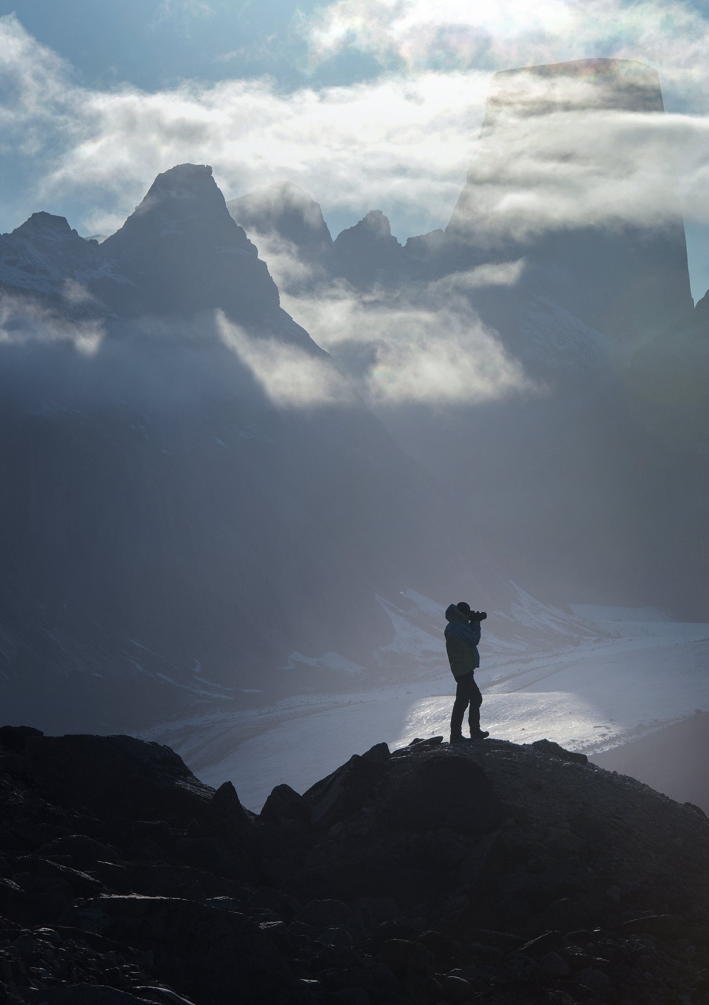 Artur in front of Mt. Asgard, looking for compositions -