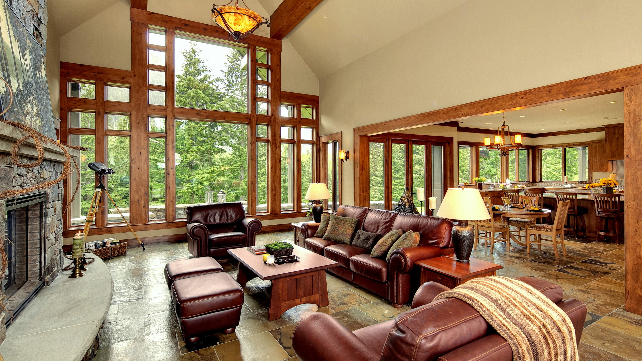 Lodge Style with a Great View   timber beams, window walls, and slate floors
