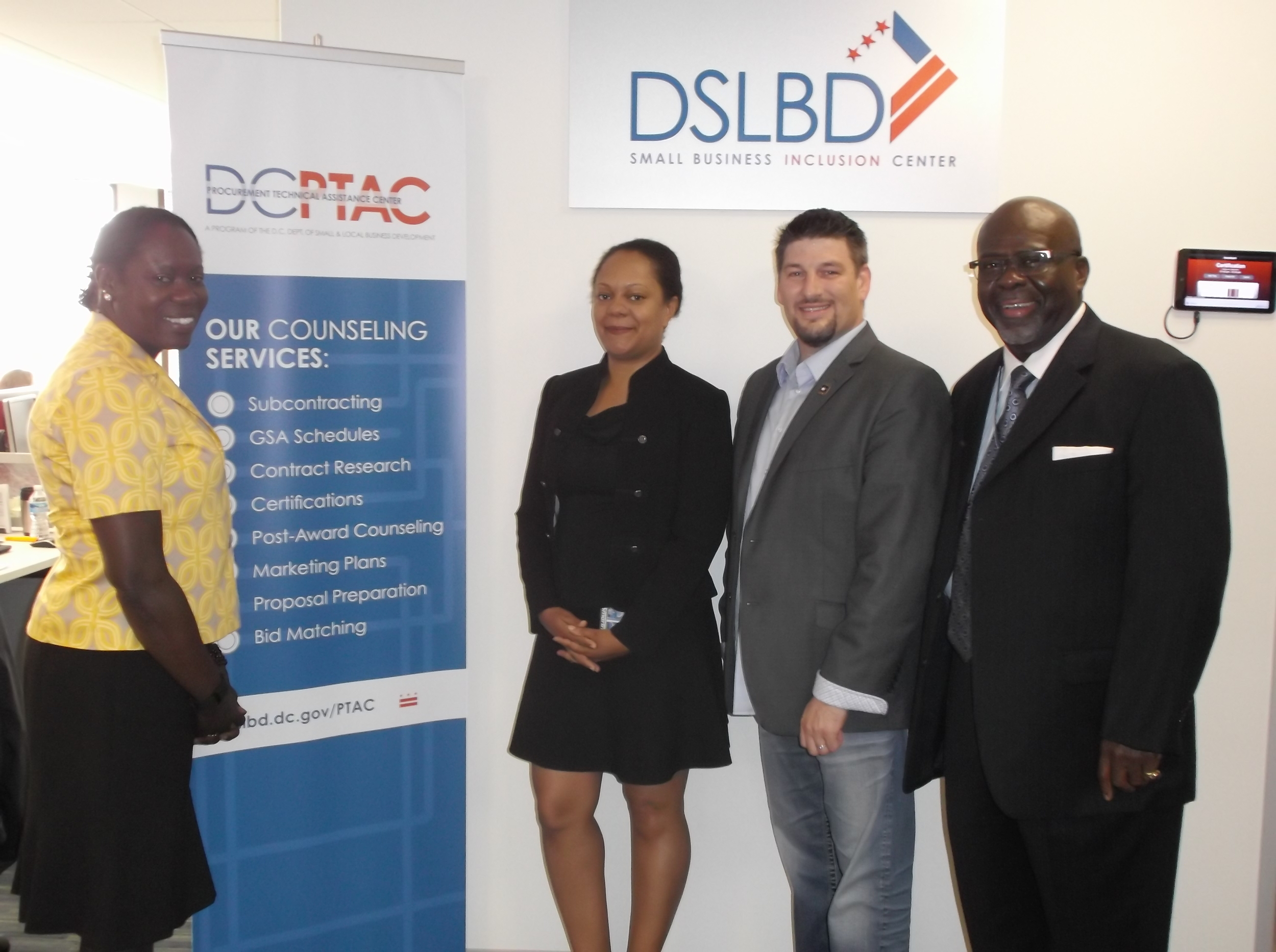 Dr. Brian Williams stands with Sheila Edmondson, Venessa Kadiri and J. Milton Goodman manager of the Dept of Small & Local Business Development.
