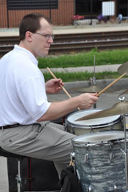 marko plays drums at famers market june 09.JPG