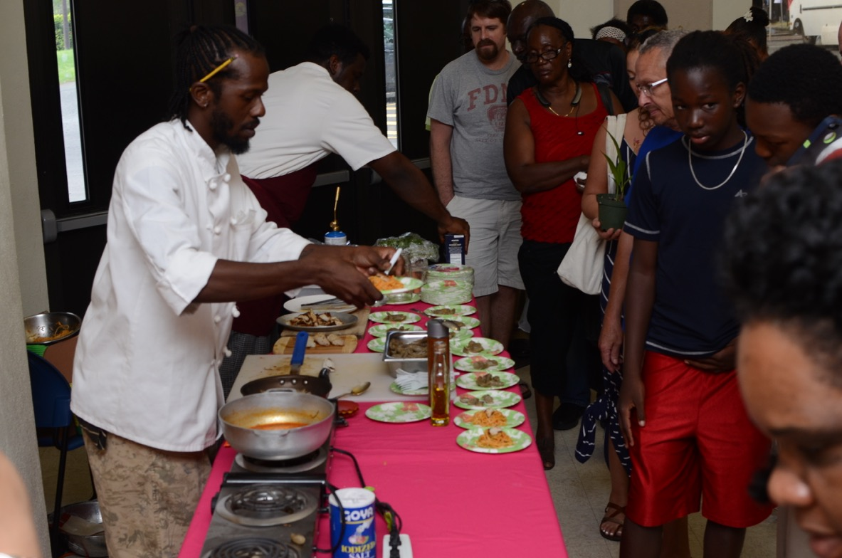 UVI World Food Day gives Chef Mark the opportunity to plate blackened lion fish for the crowds.