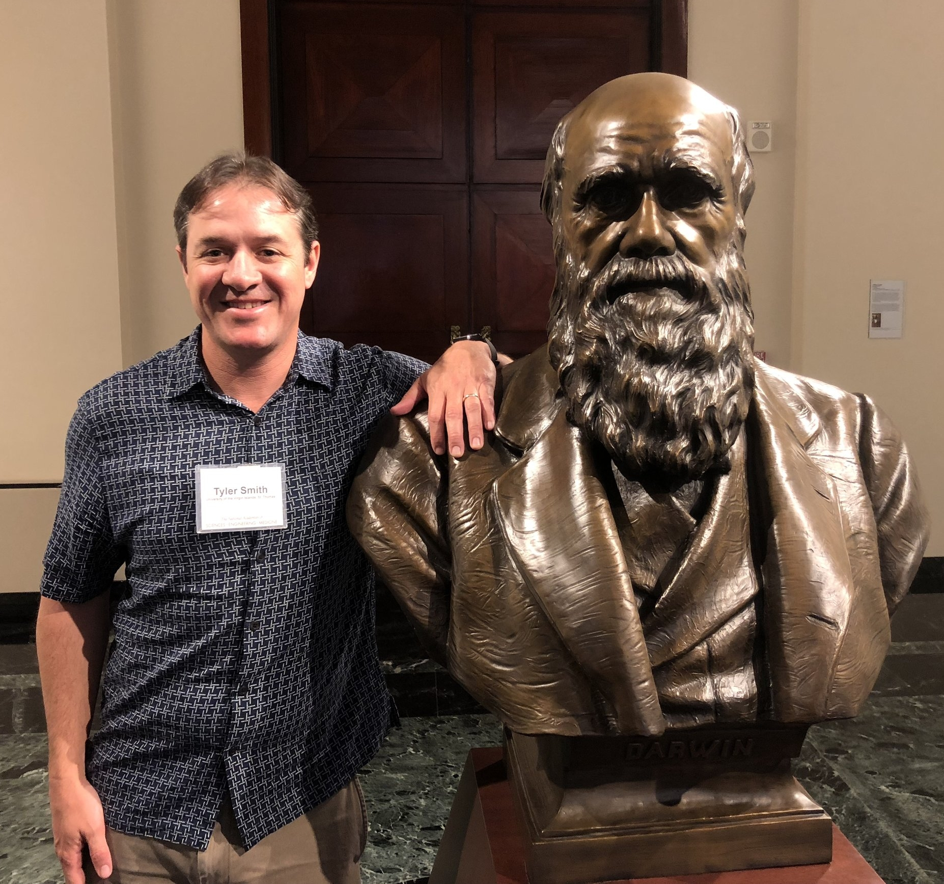Dr. Smith with a bust of Charles Darwin inside the National Academy of Sciences headquarters. The IIRCR's inaugural meeting took place on February 8, 2018.