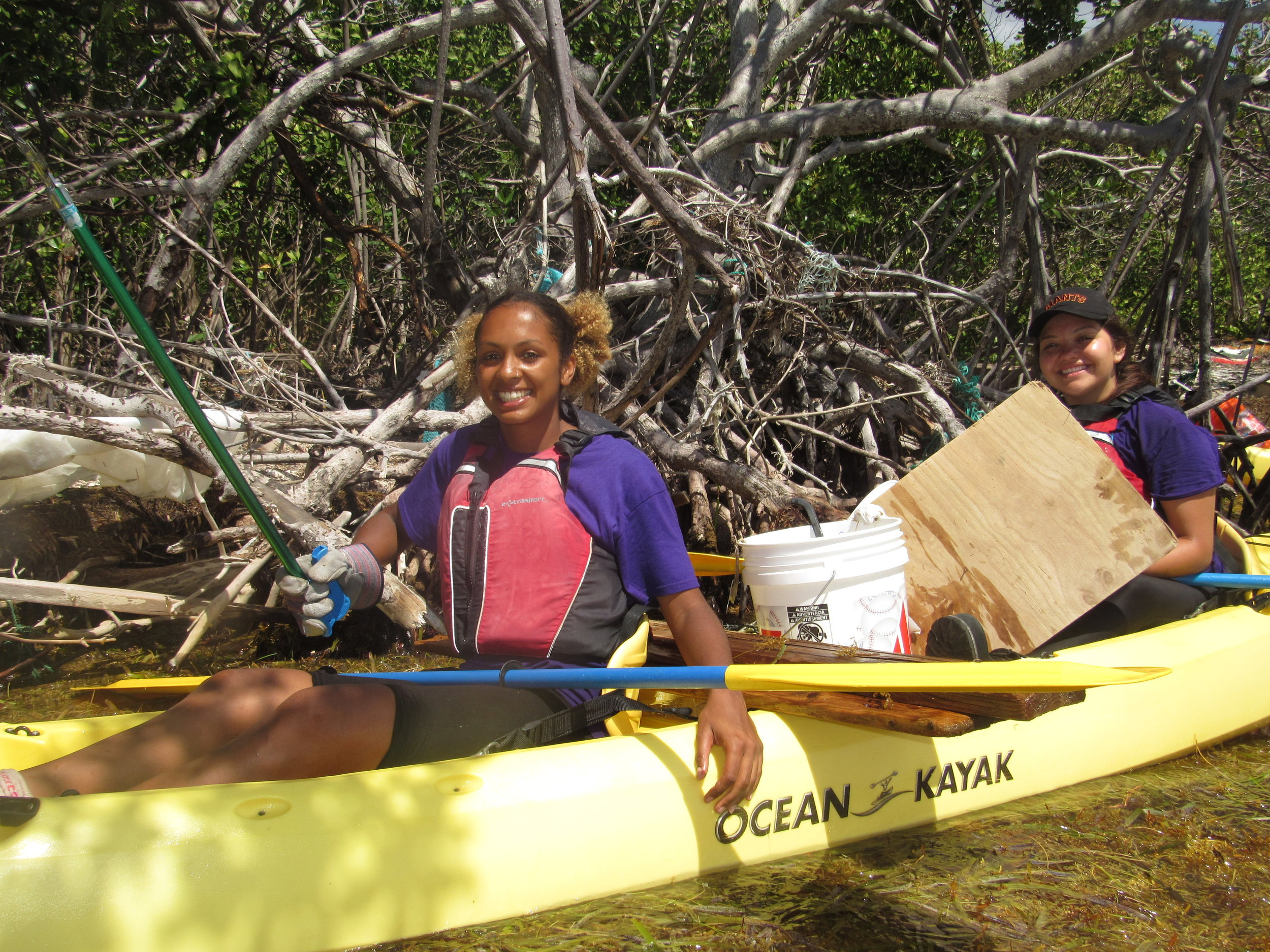All Hands and Heart volunteers work together to remove marine debris items from the St. Thomas East End Reserves.  Photo credit: Jarvon Stout