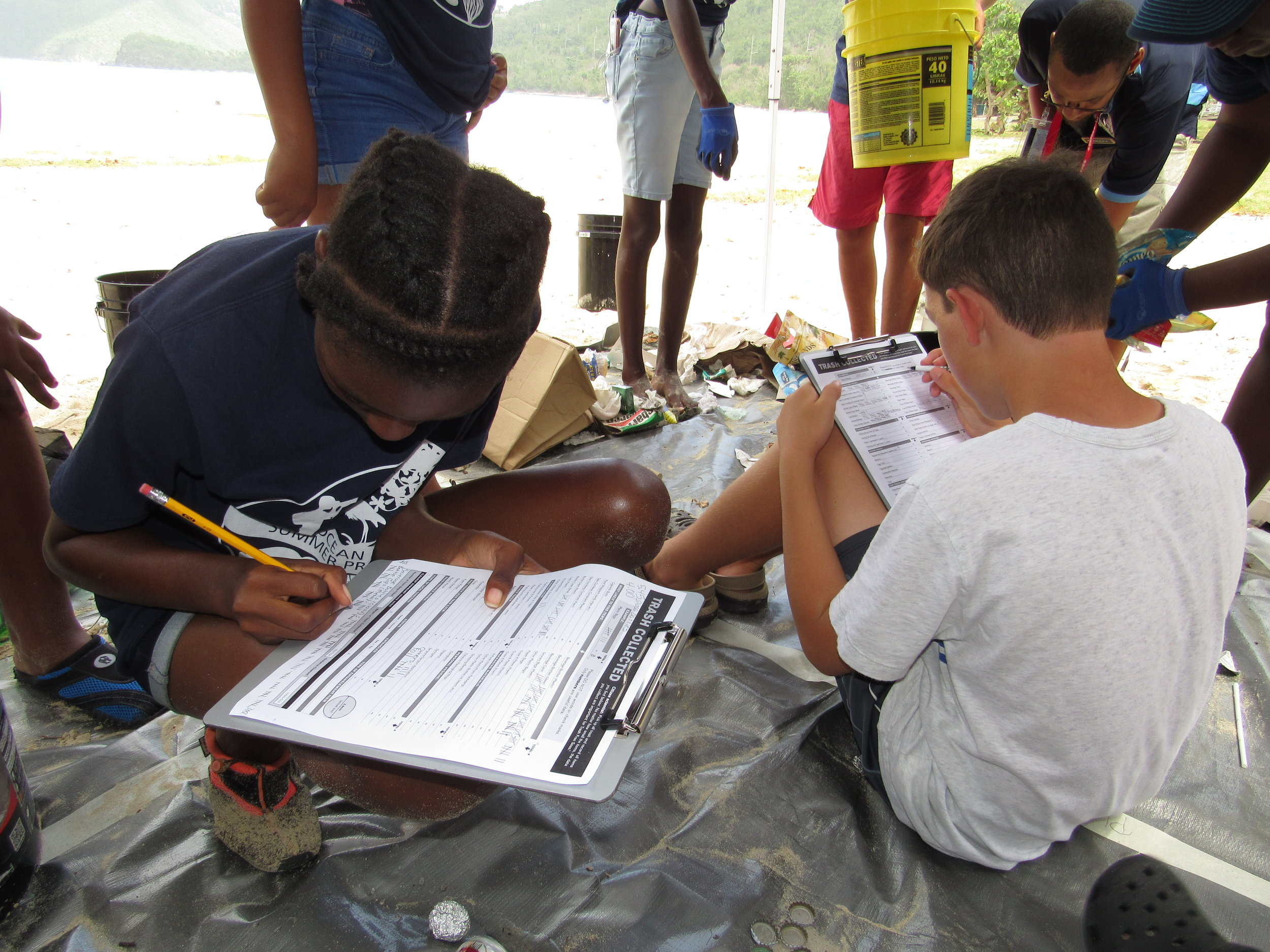YOE students tallying marine debris collected on Brewers Bay beach.