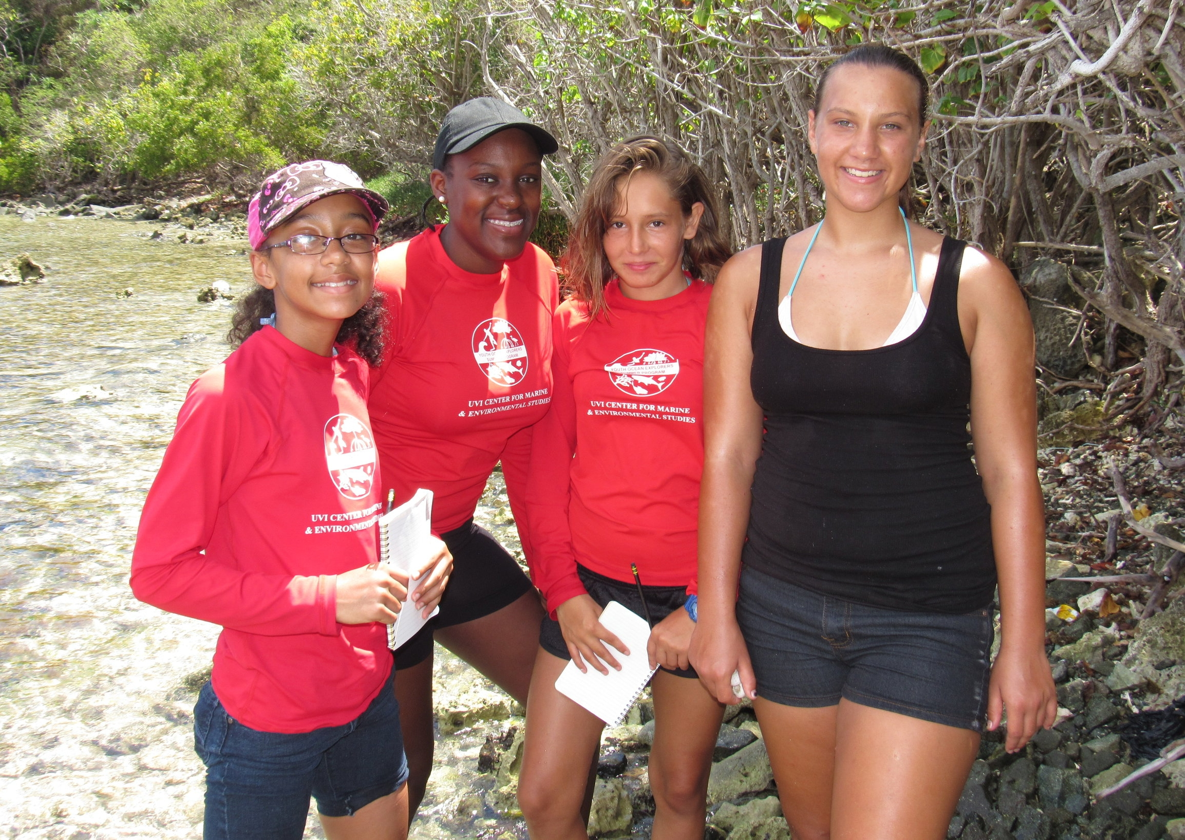 Zola  (second from left)  in 2016 with Youth Ocean Explorer students explore the shoreline around UVI's Center for Marine & Environmental Studies. Photo: Jarvon Stout.
