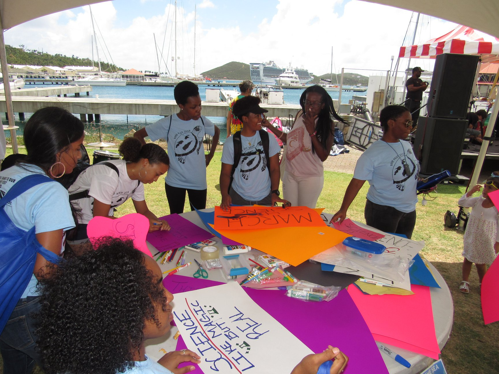 "Seen here, Science 100 students volunteered to help with Reef Fest in April 2018, an annual event hosted by VIMAS and VI-EPSCoR, to highlight some of the problems facing our oceans. The students distributed surveys to gauge participants' knowledge gained during the event and (seen here) ran the kids' table where participants wrote ""Love Letters to the Sea."""