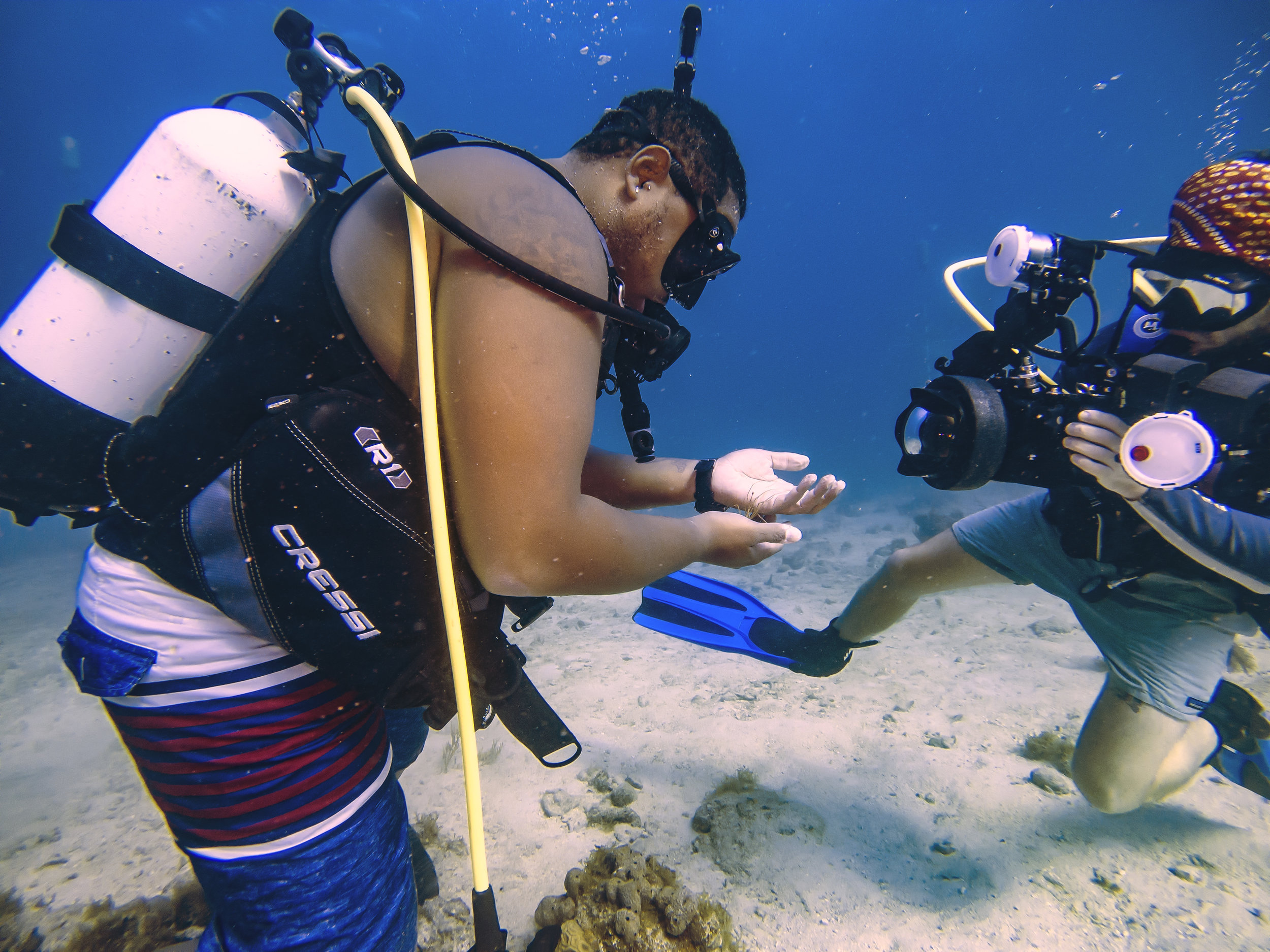 Kyle and fellow MMES student Dan Mele examine an arrowhead crab off the western shore of St. Thomas, VI. Photo: Joe Townsend