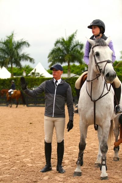 Freddie Vazquez coaches Ellery Taylor atWEF 2016.    Photo courtesy of Messenger Hill Farm.