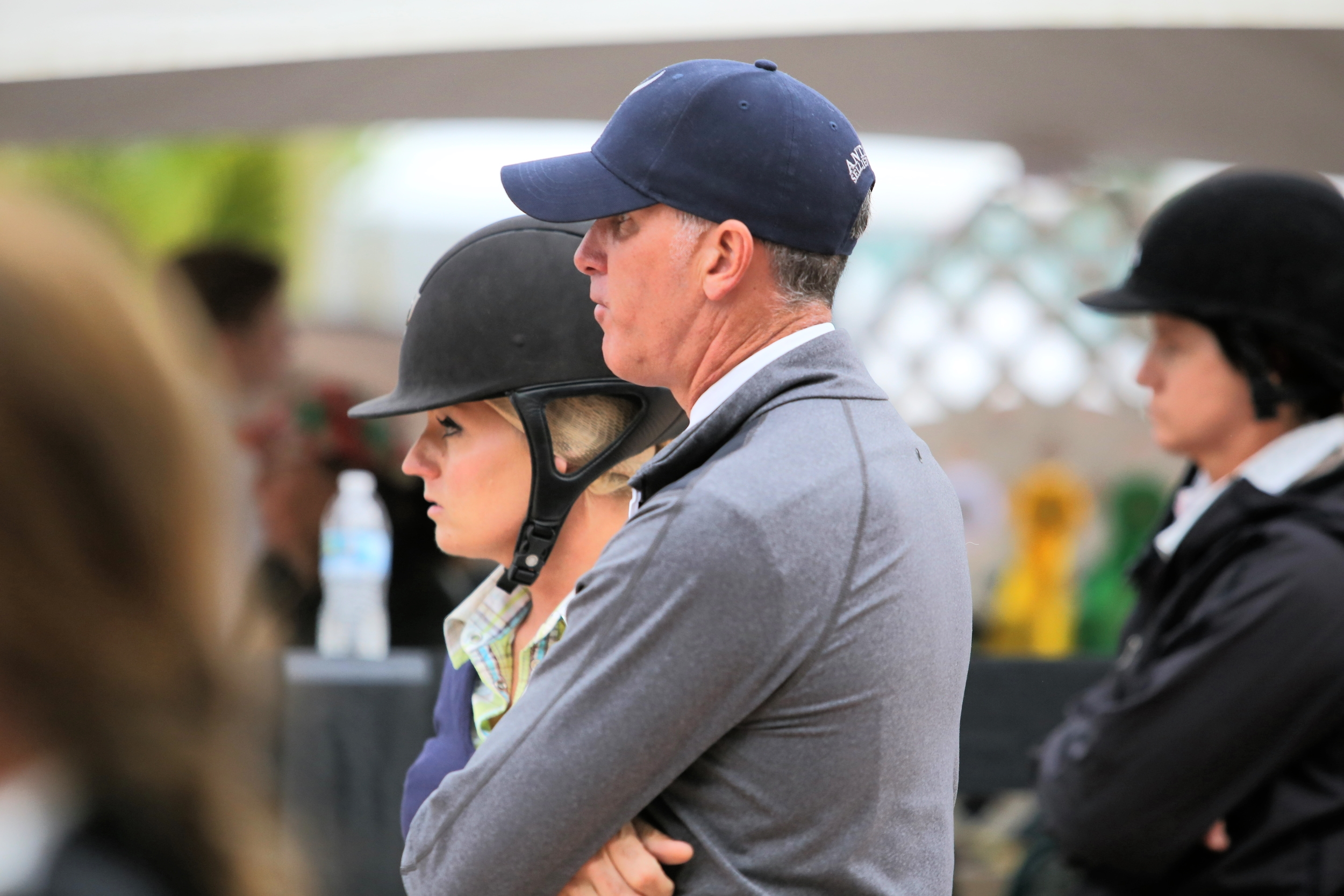 Freddie and Jodi Vazquez watch their student's round at the Winter Equestrian Festival. Photo by Carrie Wirth