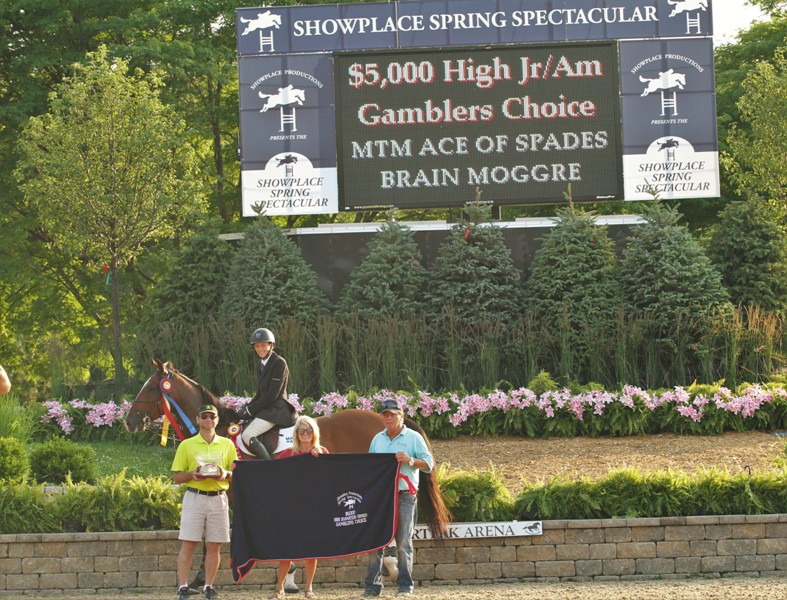 $5000 High Junior/Amateur Owner Gamblers Choice, sponsored by the Dollins Group    14-year-old Brian Moggre claims the top two places in the High Junior/Amateur Jumpers, this time in the Gambler's Choice with MTM Ace of Spades with the blue and MTM Flutterby in second. Both horses are owned by Major Wager LLC.
