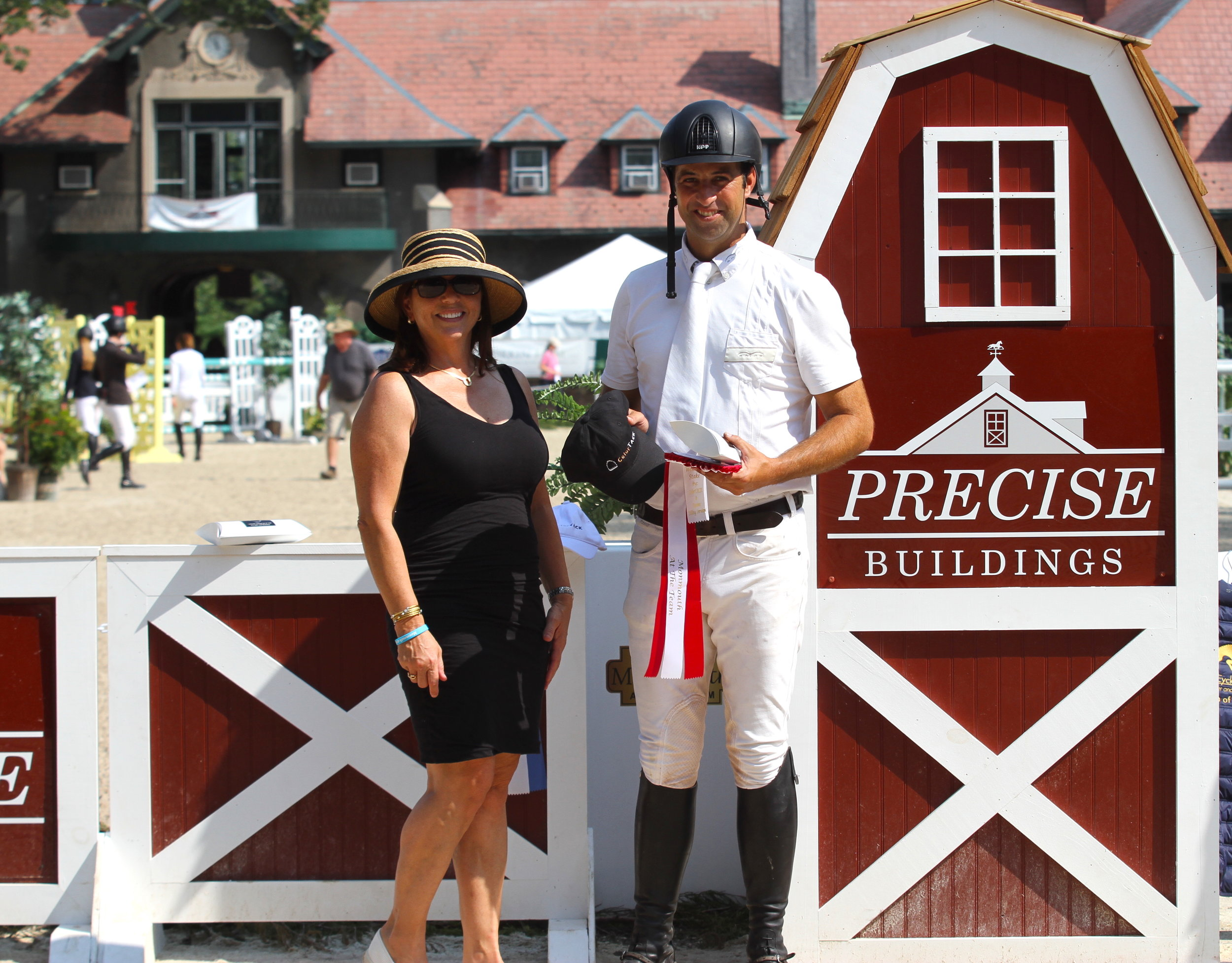 Janet Rizzo from ColorTACK presents the prize to Pablo Mejia. Photo by EQ Media
