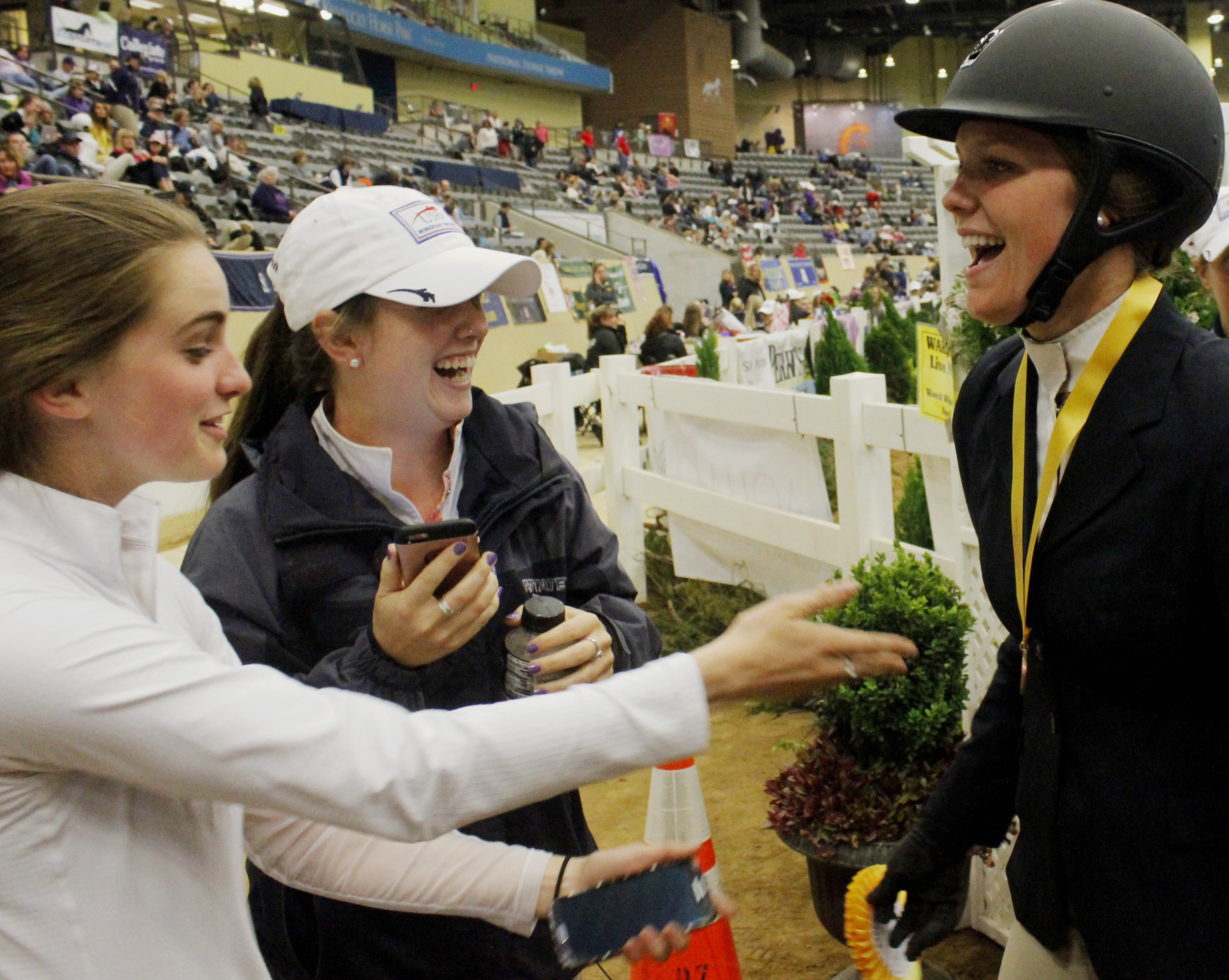 Daniella Carrissimo celebrates her ribbon with teammates at the IHSA National Championship Horse Show. Photo by Erin O'Neill
