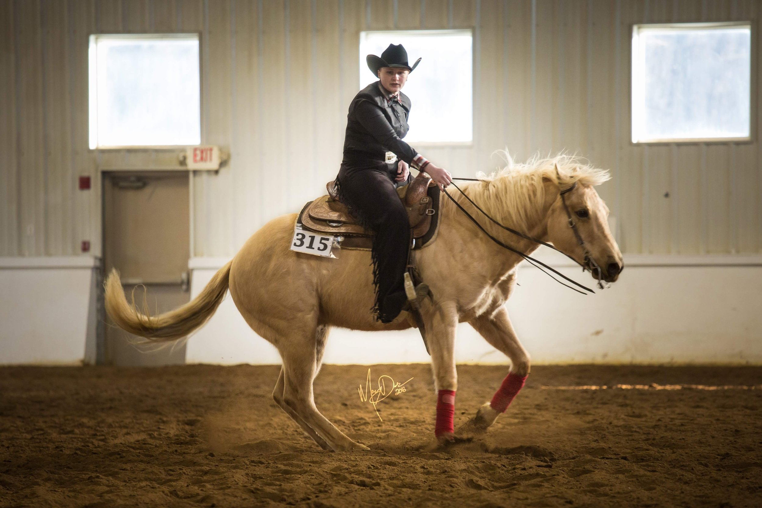 Lily Atkinson competing in Open Reining at an IHSA show. Photo by Eminent Equine