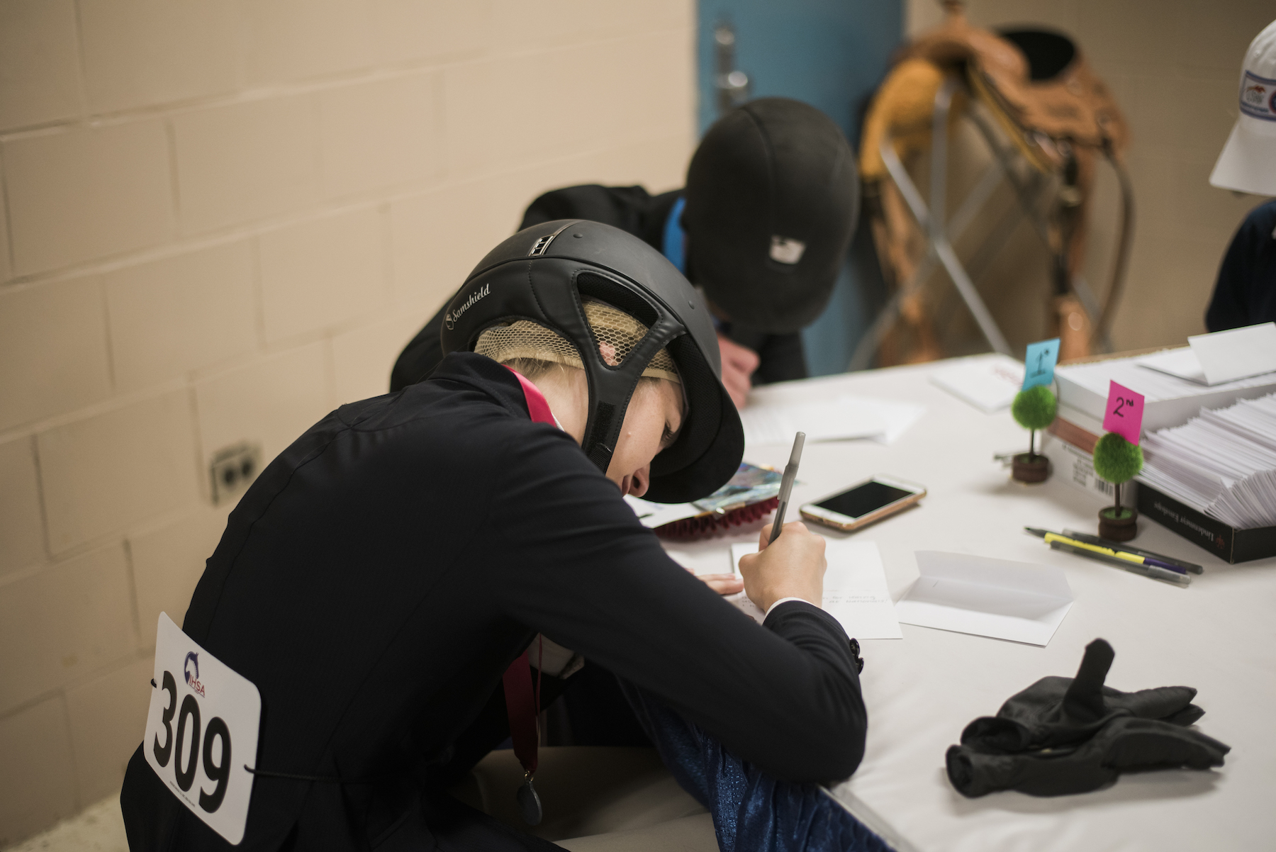 Halle Kutsche and Michael Andrade write thank you notes to the sponsors. Photo EQ by Media