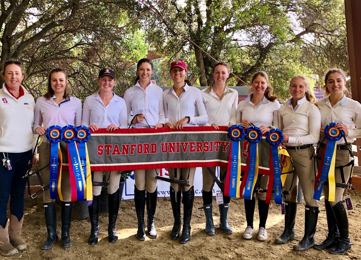 Kelsi Okun third from the right with her teammates and coach Vanessa Bartsch. Photo courtesy of Stanford University