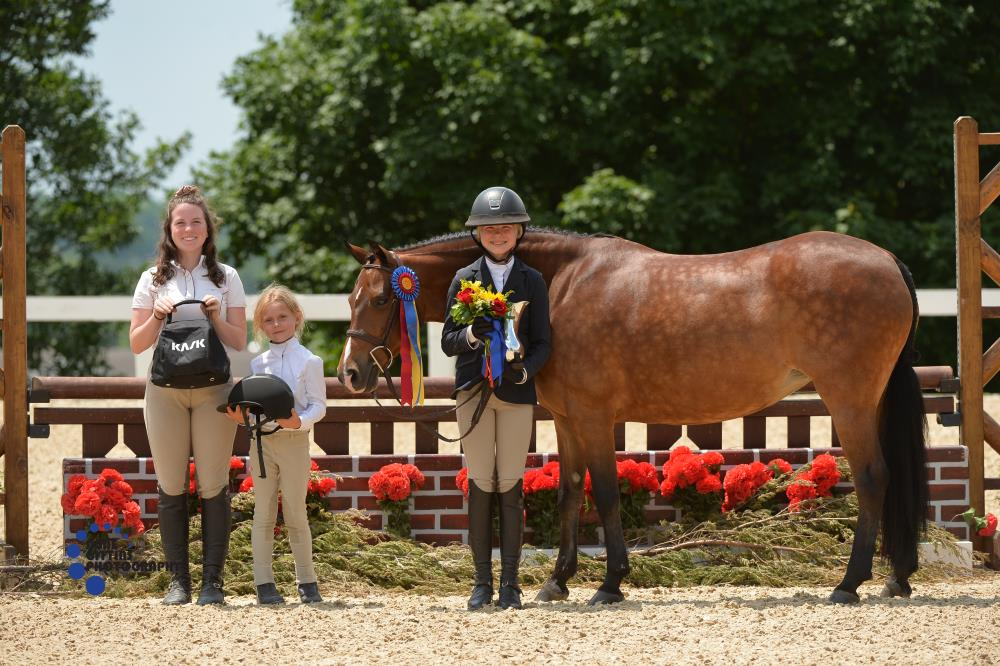 Medium Pony Hunter champions Don't Push My Buttons and Reilly Gogul were awarded a Kask Helmet. Photo by Anne Gittins Photography
