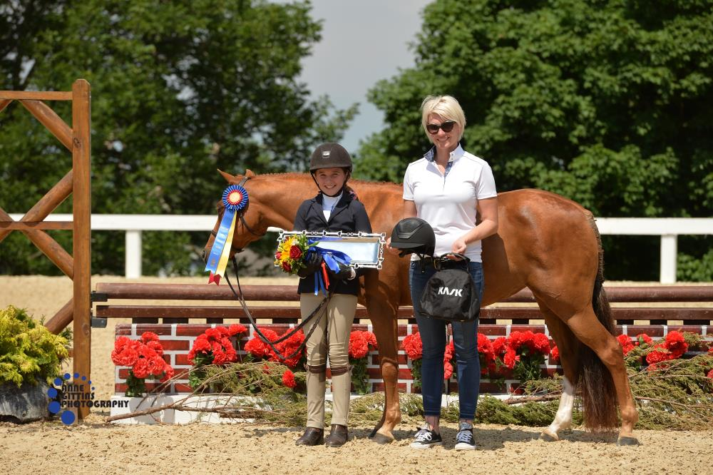 Krista Schneider from Kask presented each of the Pony Hunter champions a Kask Helmet. Pictured are Small Pony Hunter champions So Enchanted and Carolyn Colter. Photo by Anne Gittins Photography