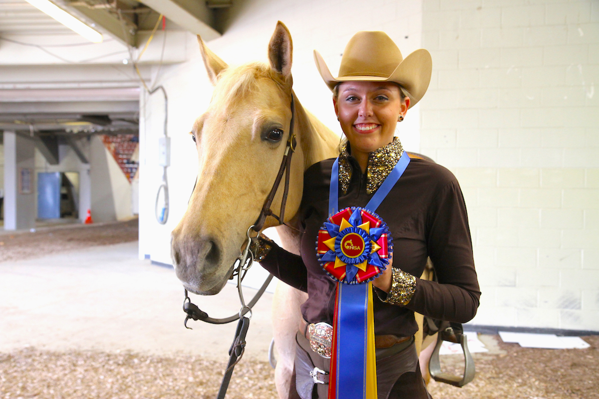 Morgan Knerr and Brie, owned by Karen Black, won the IHSA 2018 NRHA Individual Open Reining championship. Photo by EQ Media