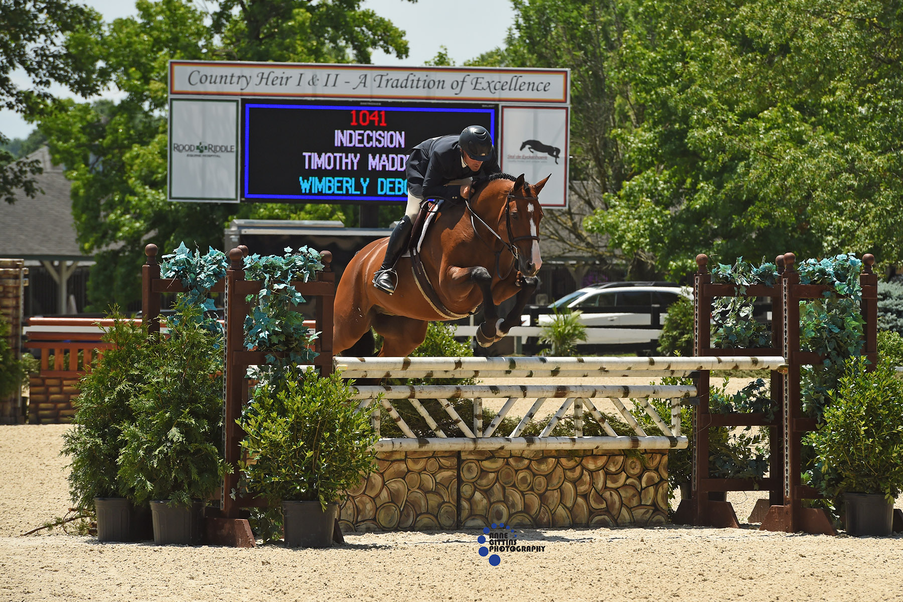 Timothy Maddrix and Indecision won the $30,000 USHJA International Hunter Derby  during Week II in 2018. Photo by Anne Gittins Photography