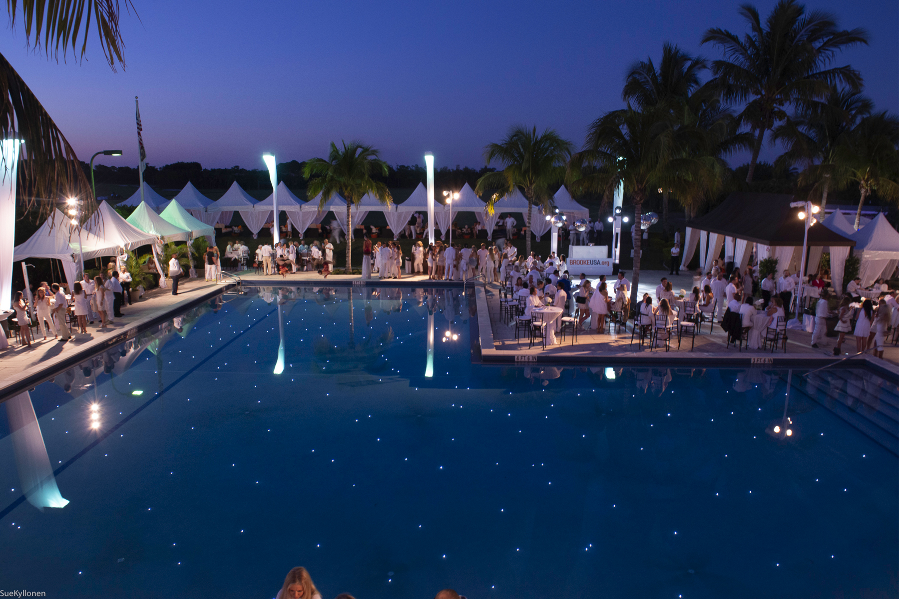 The cabana-lined pool set a beautiful stage for Brooke USA's Sunset Polo™ & White Party. Photo by Sue Kyllonen