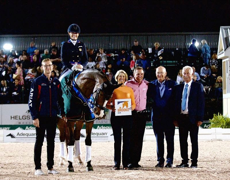 Ashley Holzer and Havanna 145 won the FEI Grand Prix Freestyle CDI 3*. They are pictured with Nate Tucker, Brooke USA Board Member Marcia Kulak, Allyn Man from Adequan, Michael Stone, president of Equestrian Sport Productions and judge Stephen Clark. Photo by EQ Media.