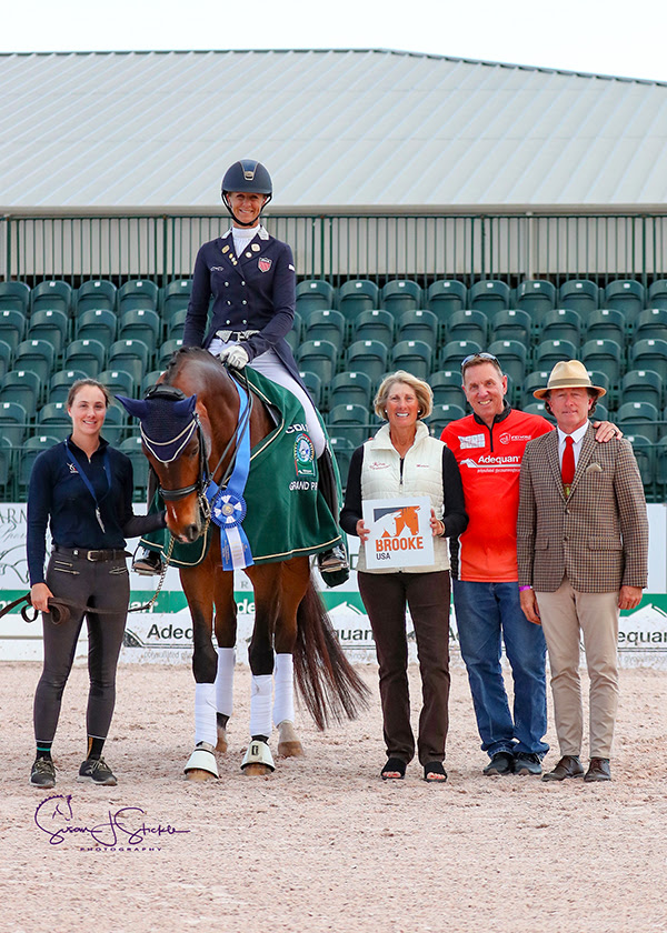 Brooke USA Board Member Marcia Kulak presented the award to Heather Blitz and Semper Fidelis for the FEI Grand Prix CDI 3*. Photo by Susan Stickle Photography
